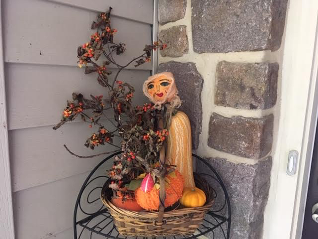 My pumpkin lady greeting visitors to my fall front door. (Photo by Charlotte Ekker Wiggins)