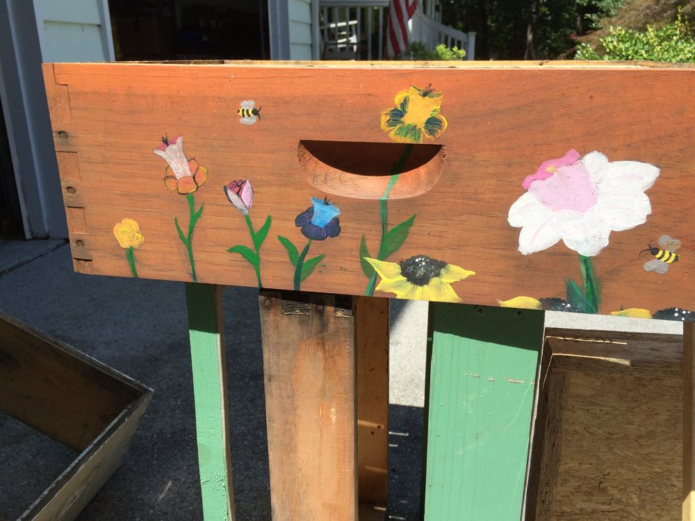 This hive box was painted by high school students in a local art class.