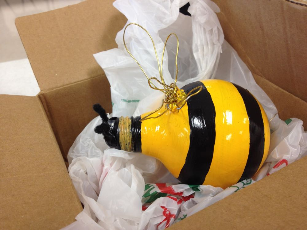 This old lightbulb was painted and recycled as a bee ornament gift.