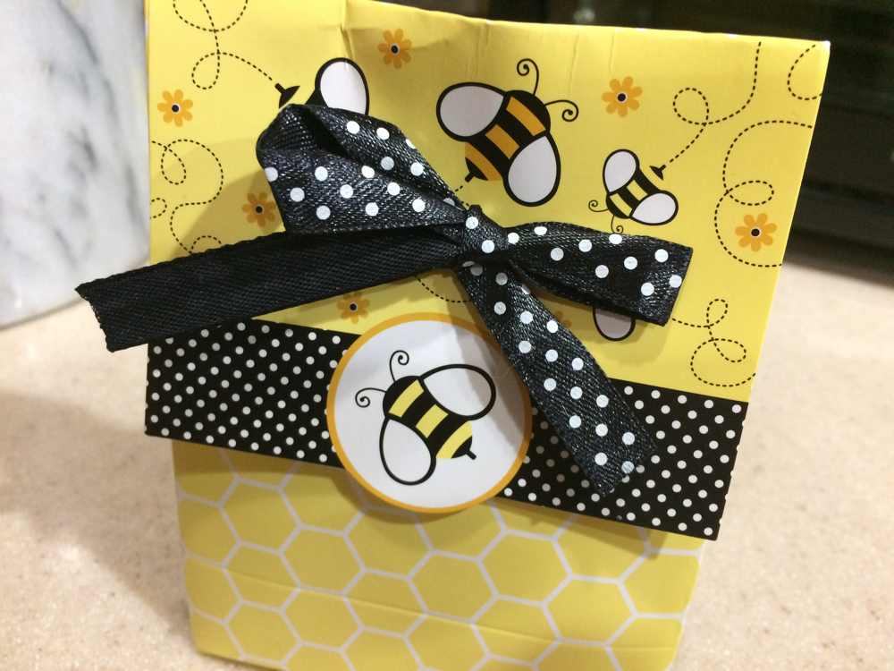 One way to give your brother bees for Christmas is to put a gift certificate in a package with bees on it.