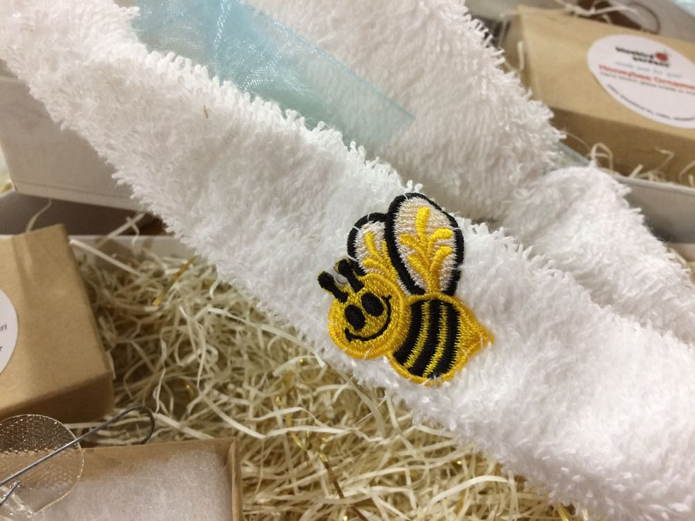Bee sweat band made out of terry cloth with elastic band on the back.