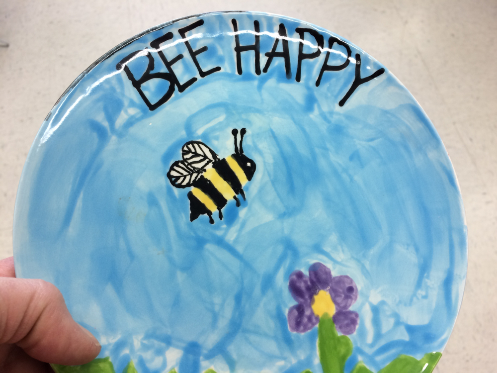 Sweet find at a local Goodwill store, this little bright blue plate with a bee on it.