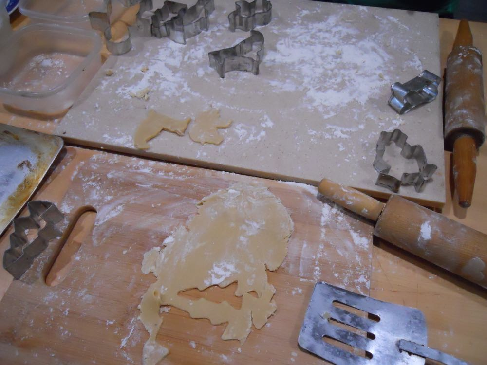 Save flour to keep dough from sticking to the cutting board and use spatula to remove cutouts.