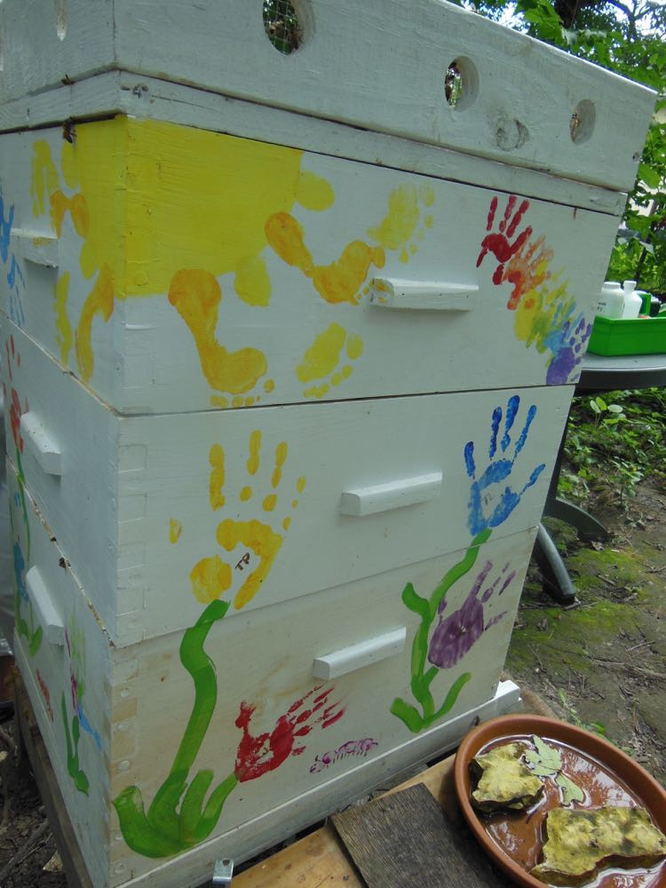 Kids hand prints help to give this hive a distinct personality and look.