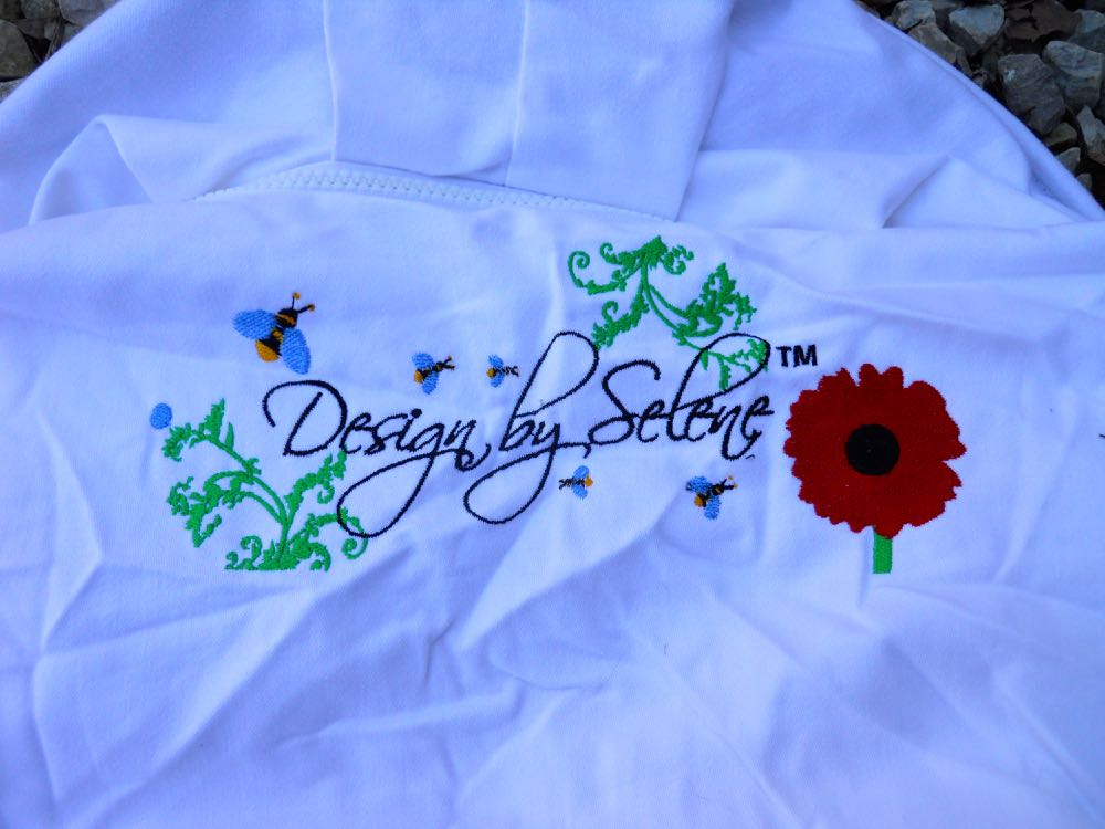 The back of my new beekeeping suit has a sweet design including its own little bees.