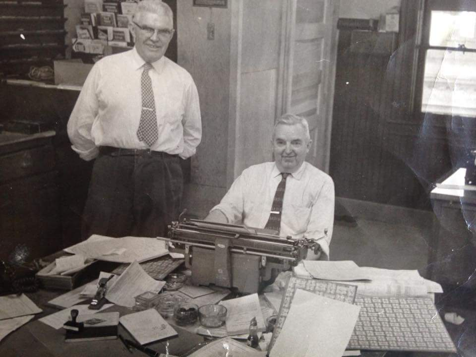 Clifford Combs and Thomas Combs working in the Coraopolis Station office.