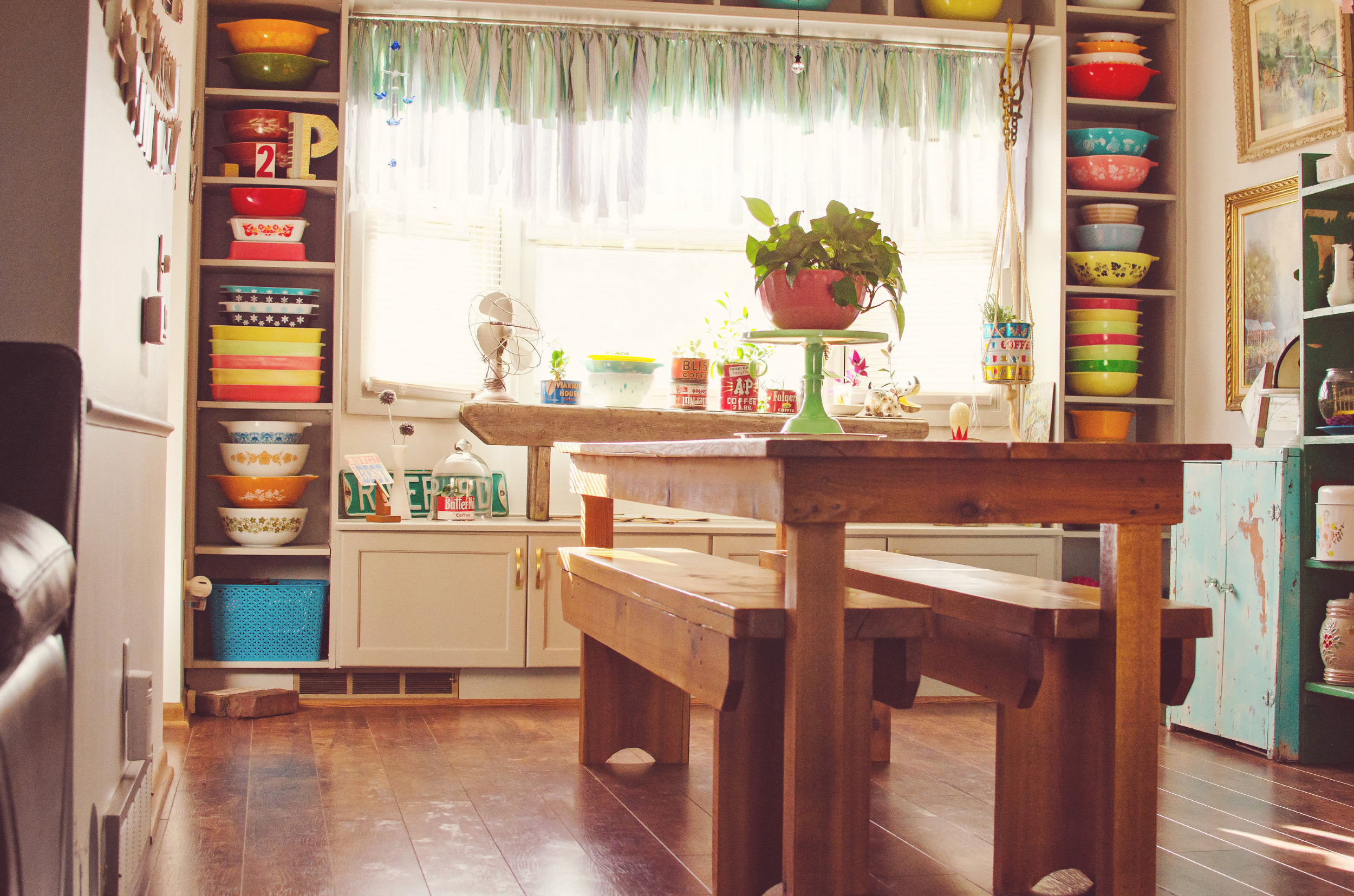Dining room design with floor to ceiling shelving of vintage Pyrex. | hprallandco.com