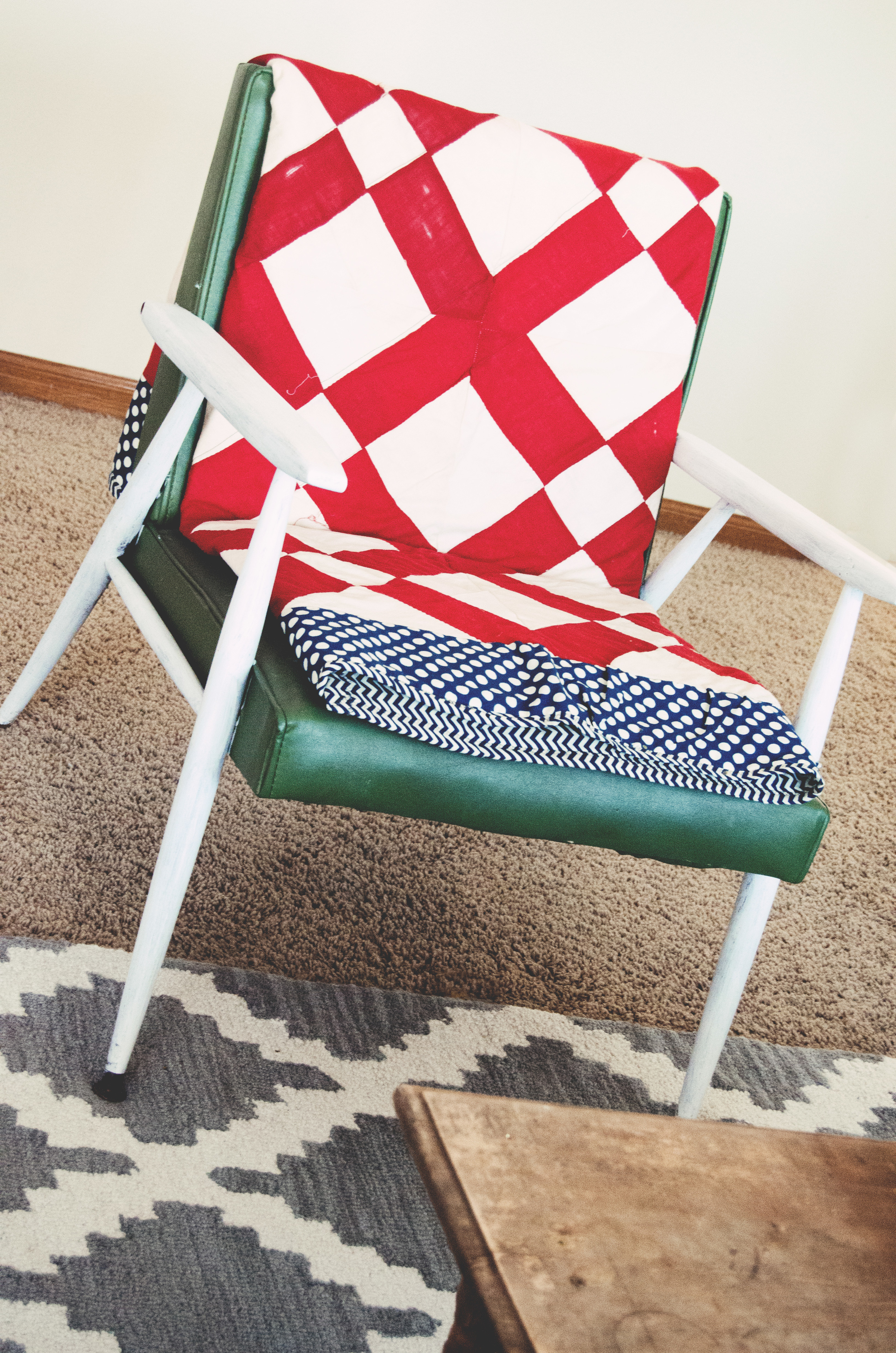 Vintage green chair with a red, white, and blue quilt. | hprallandco.com
