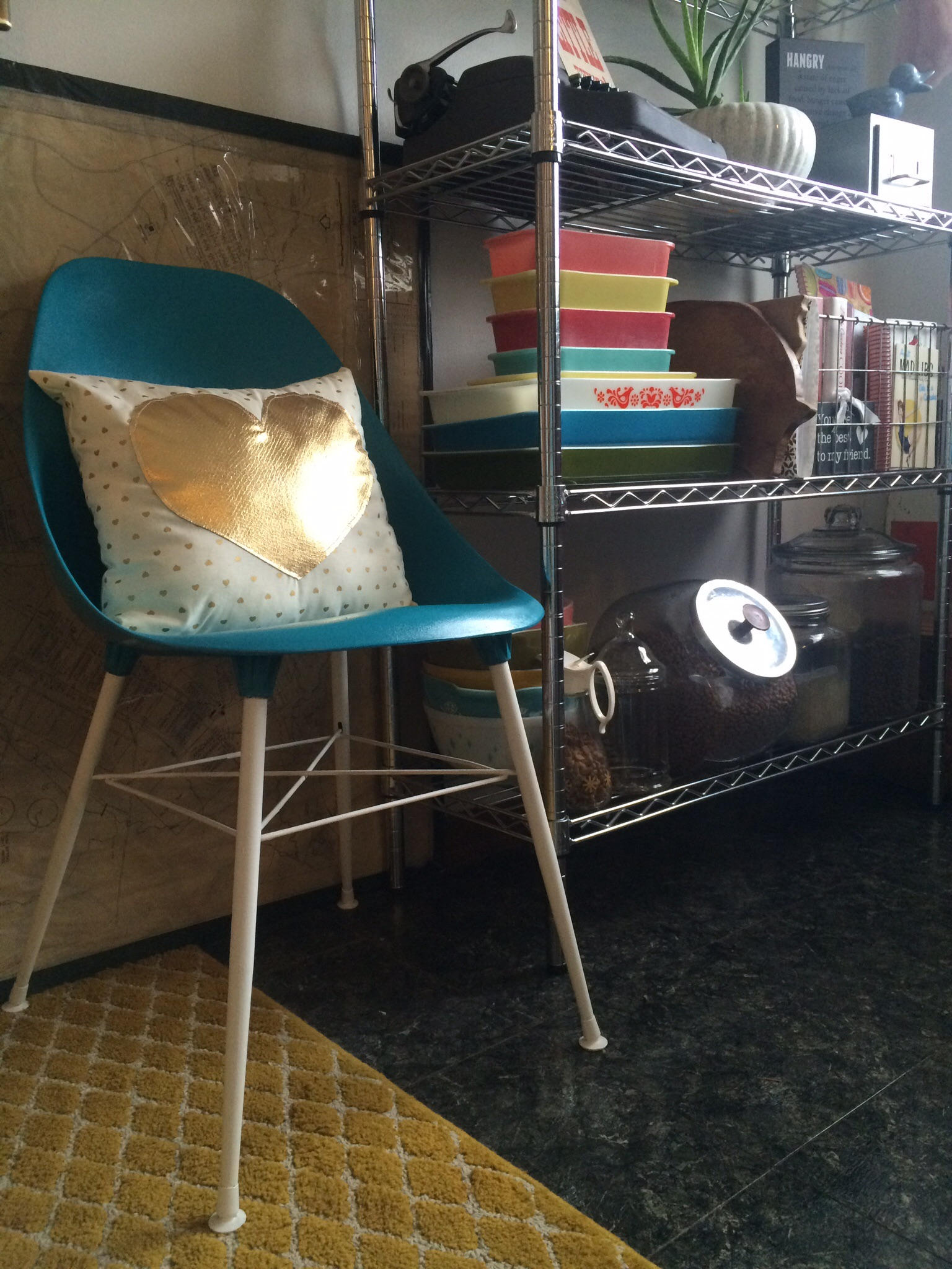 Teal vintage chair with a white and gold throw pillow.    RustopiaConsulting.com