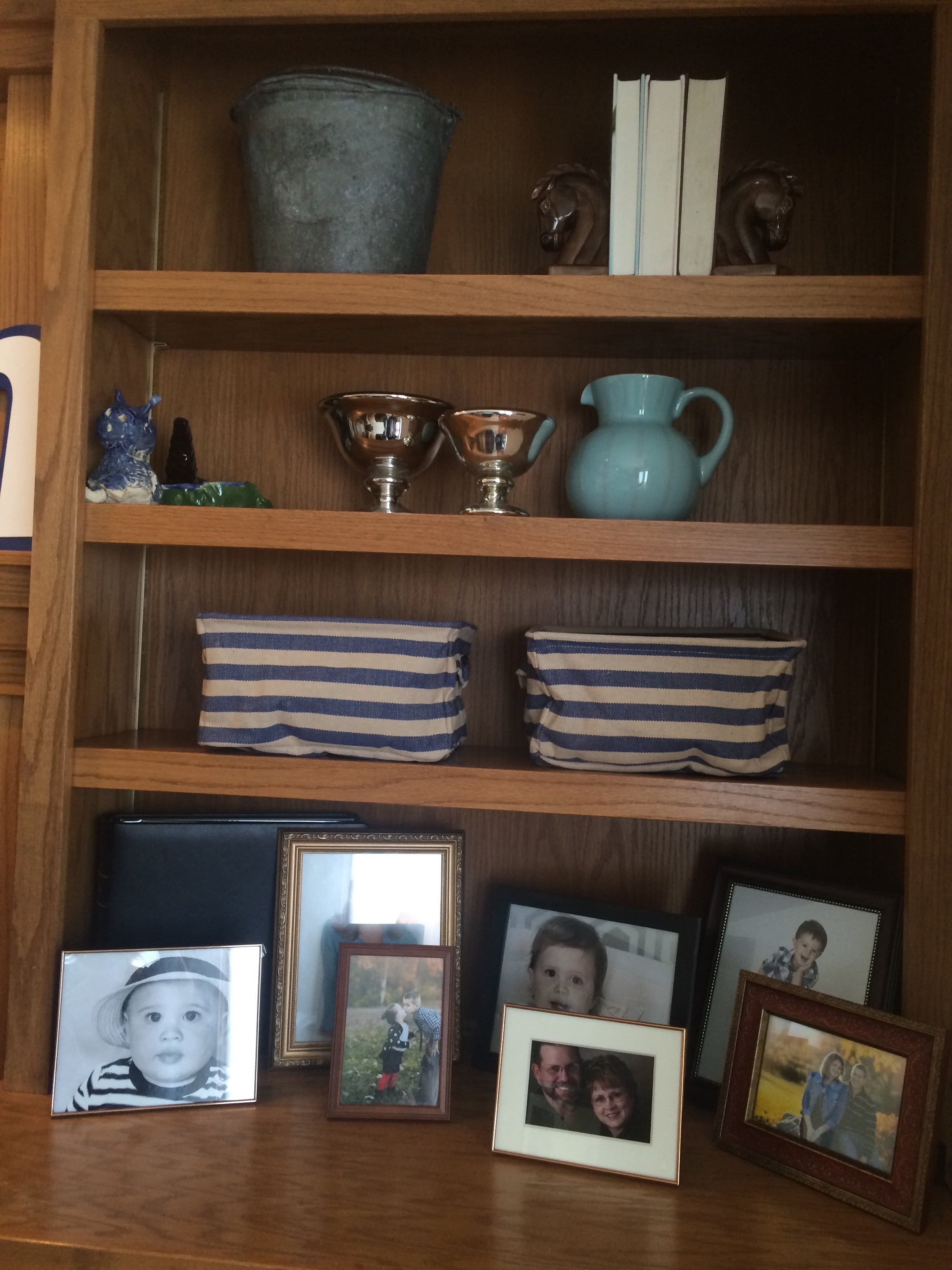 Built-In shelves decorated with pictures. || RustopiaConsulting.com