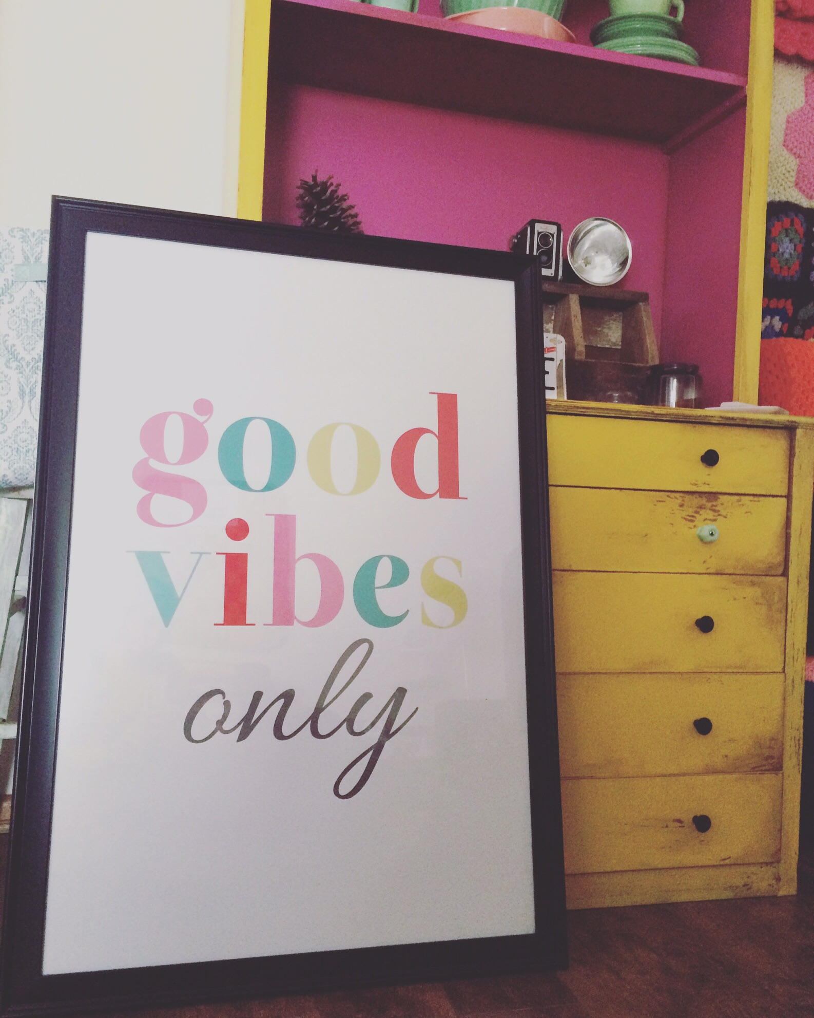 """Over-sized """"Good Vibes Only"""" colorful typography print in a frame. 