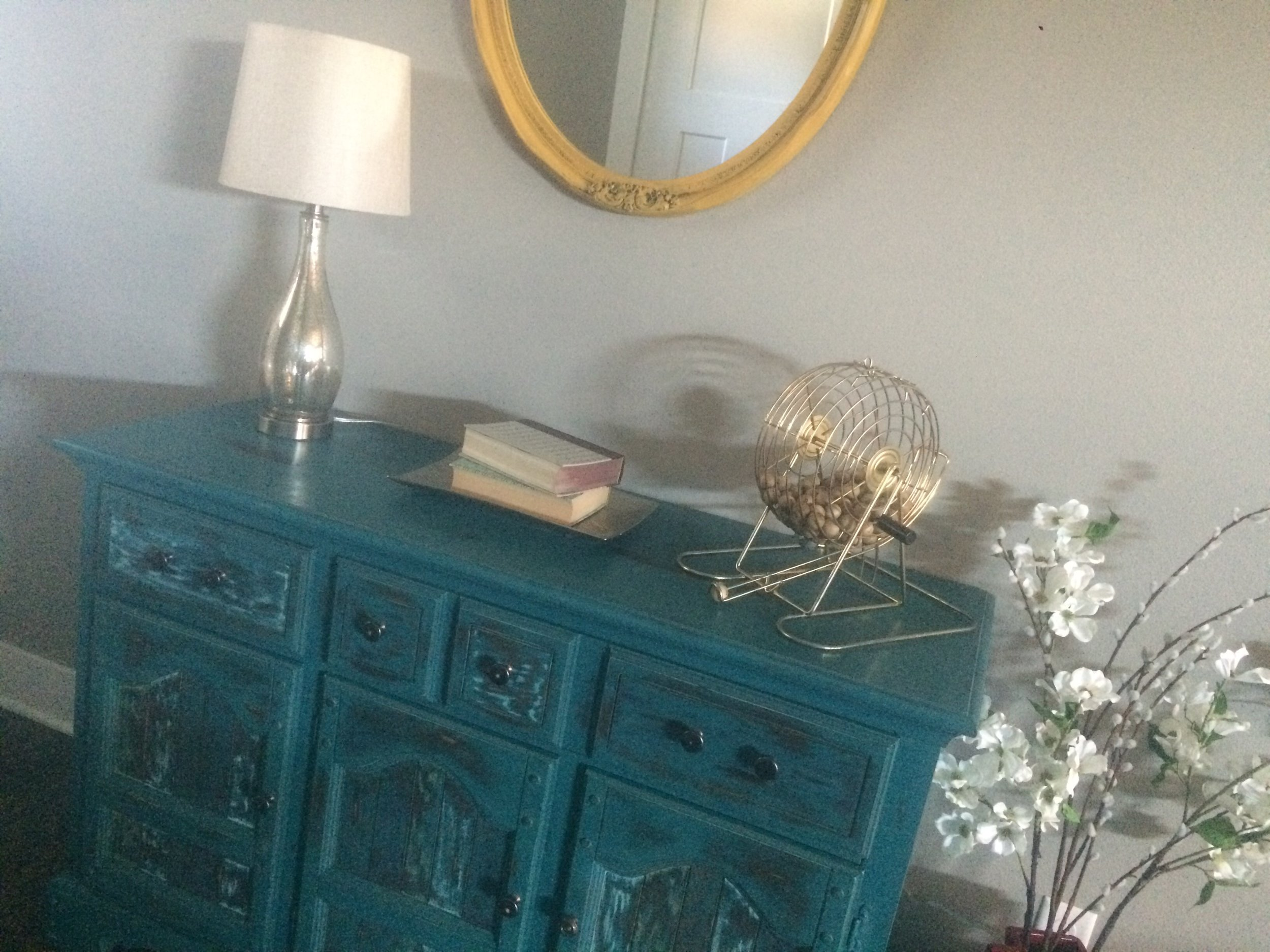 Blue Buffet styled with a lamp, books, and flowers. || RustopiaConsulting.com