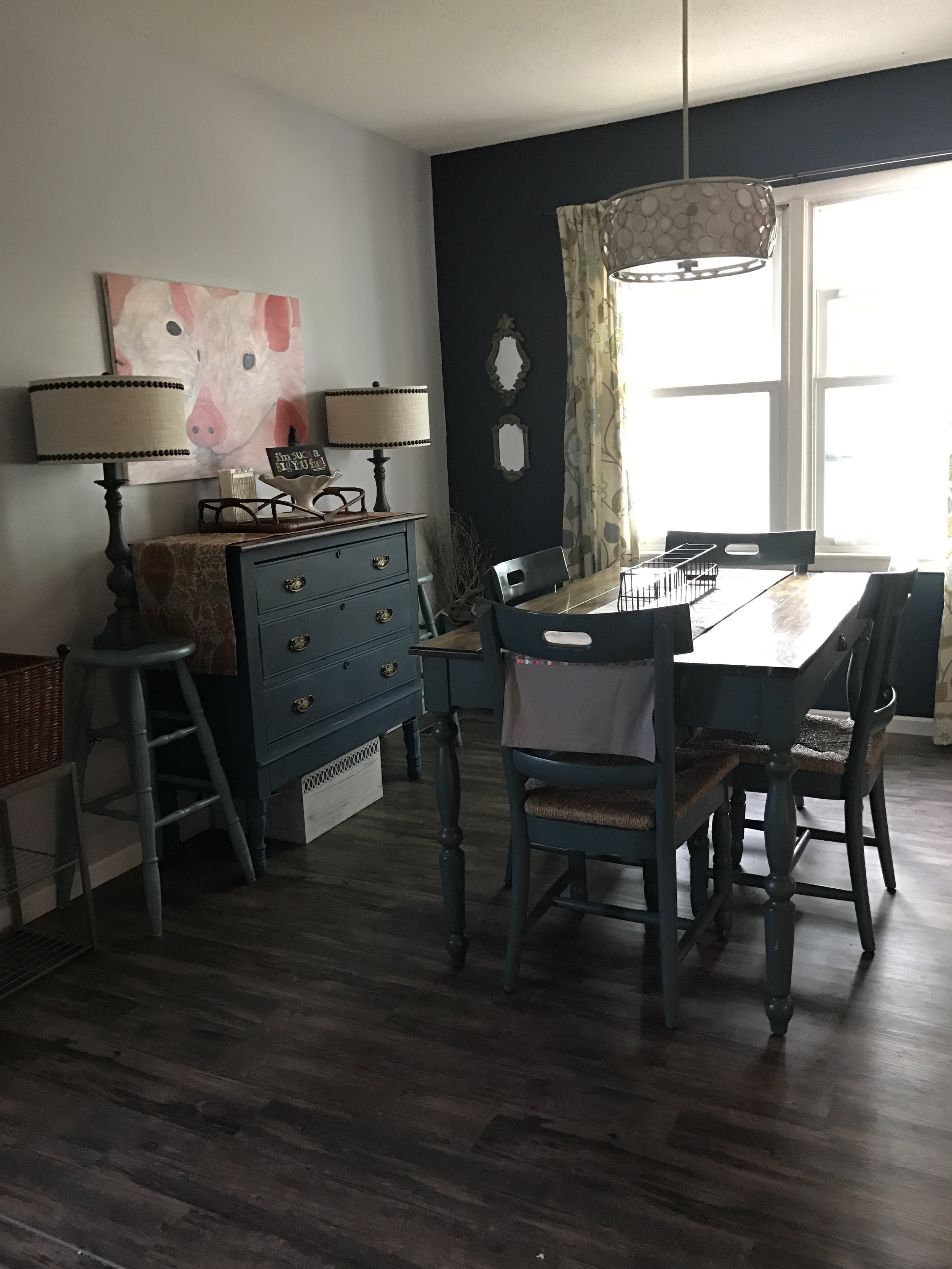 Dining room with a blue table and chair set, and a blue buffet. || RustopiaConsulting.com