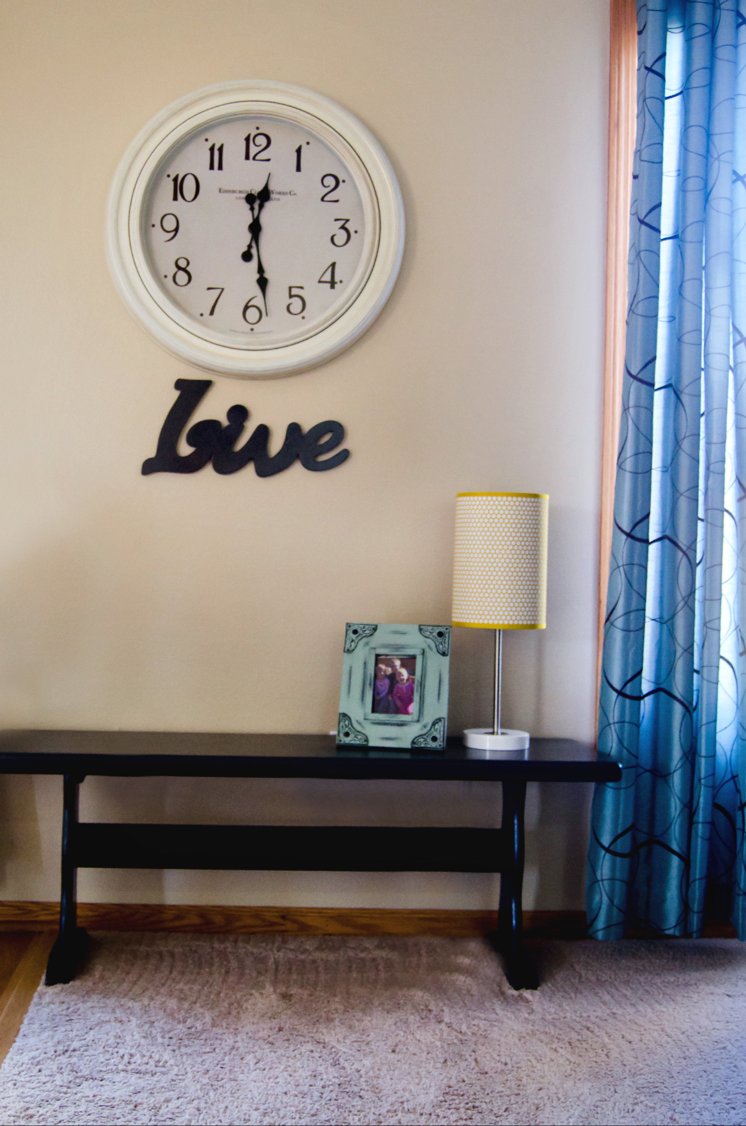 Wall clock, typography sign, over an entryway bench. | hprallandco.com