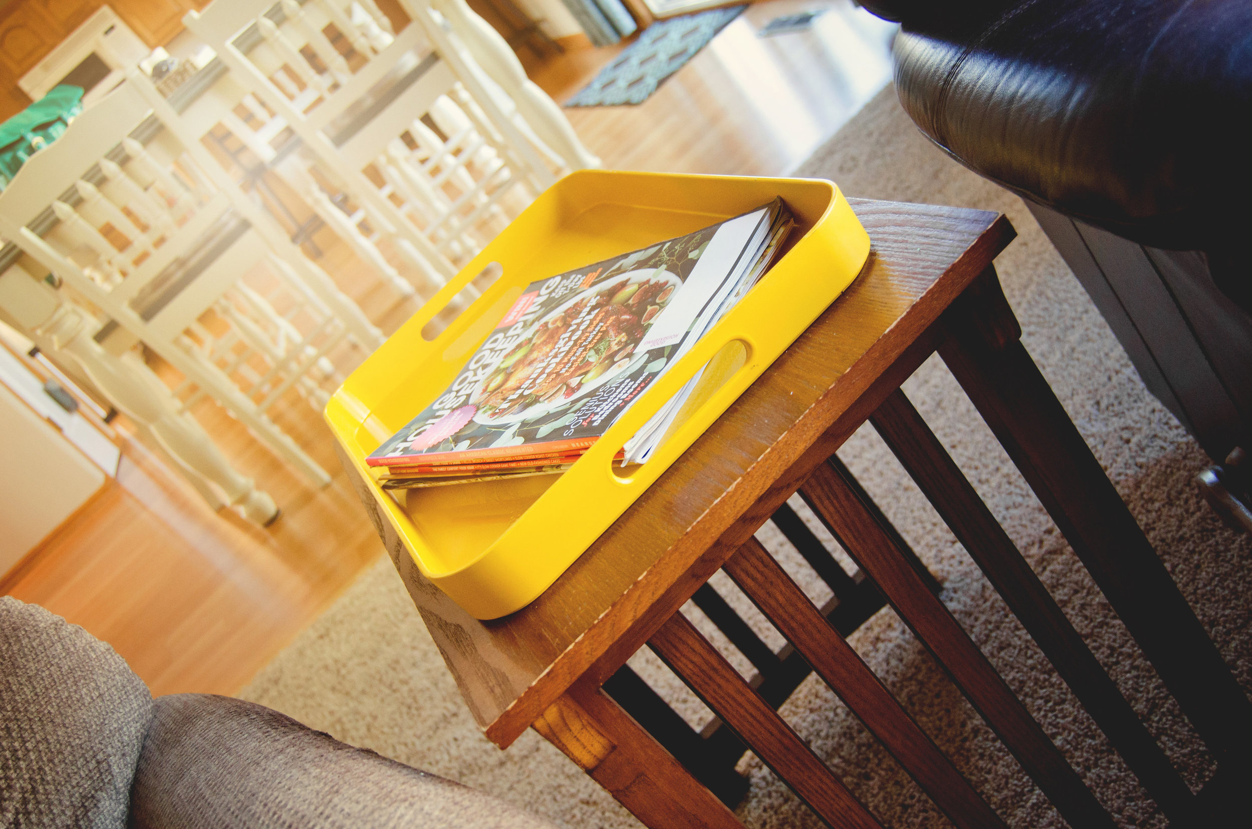 Bright yellow tray as a magazine holder. | hprallandco.com