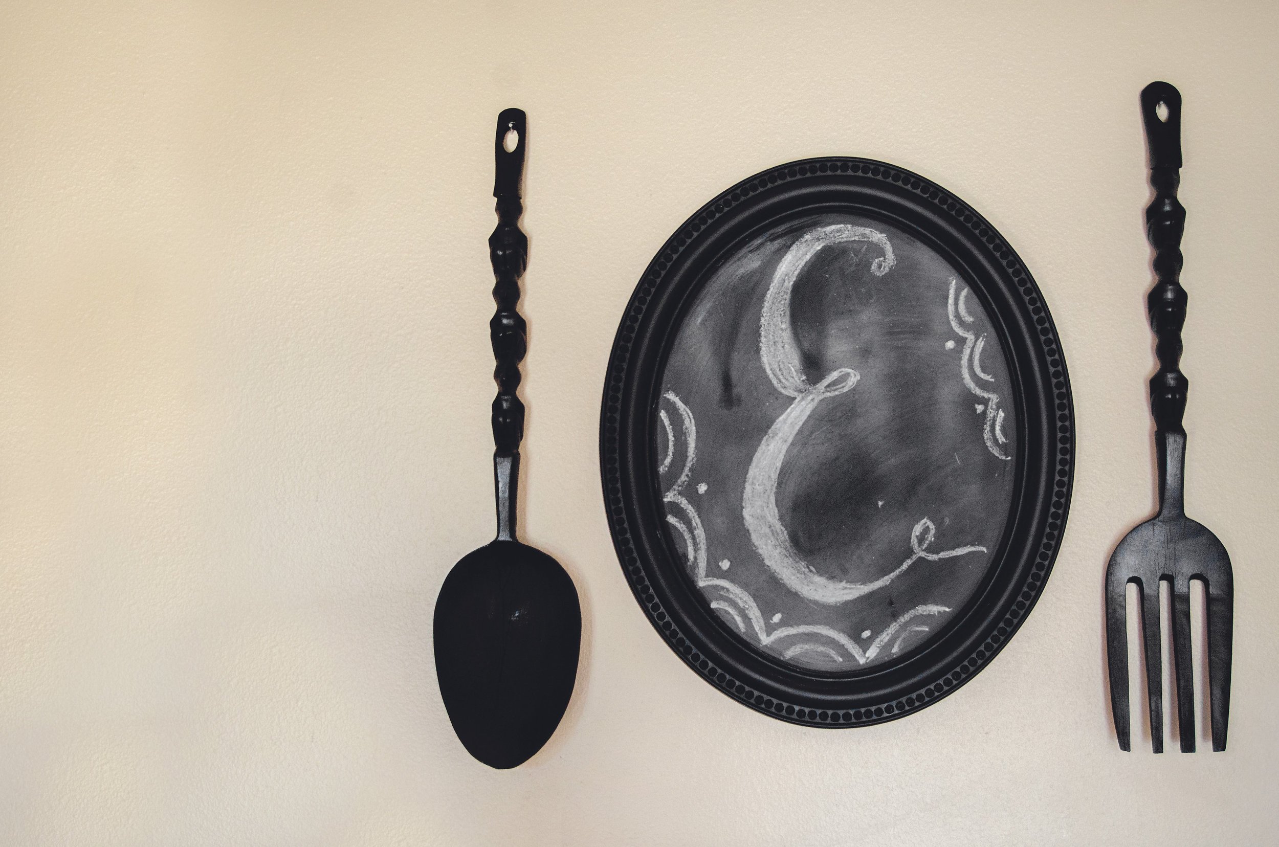 Over sized fork and spoon with a chalkboard plate. H.Prall & Co. | hprallandco.com
