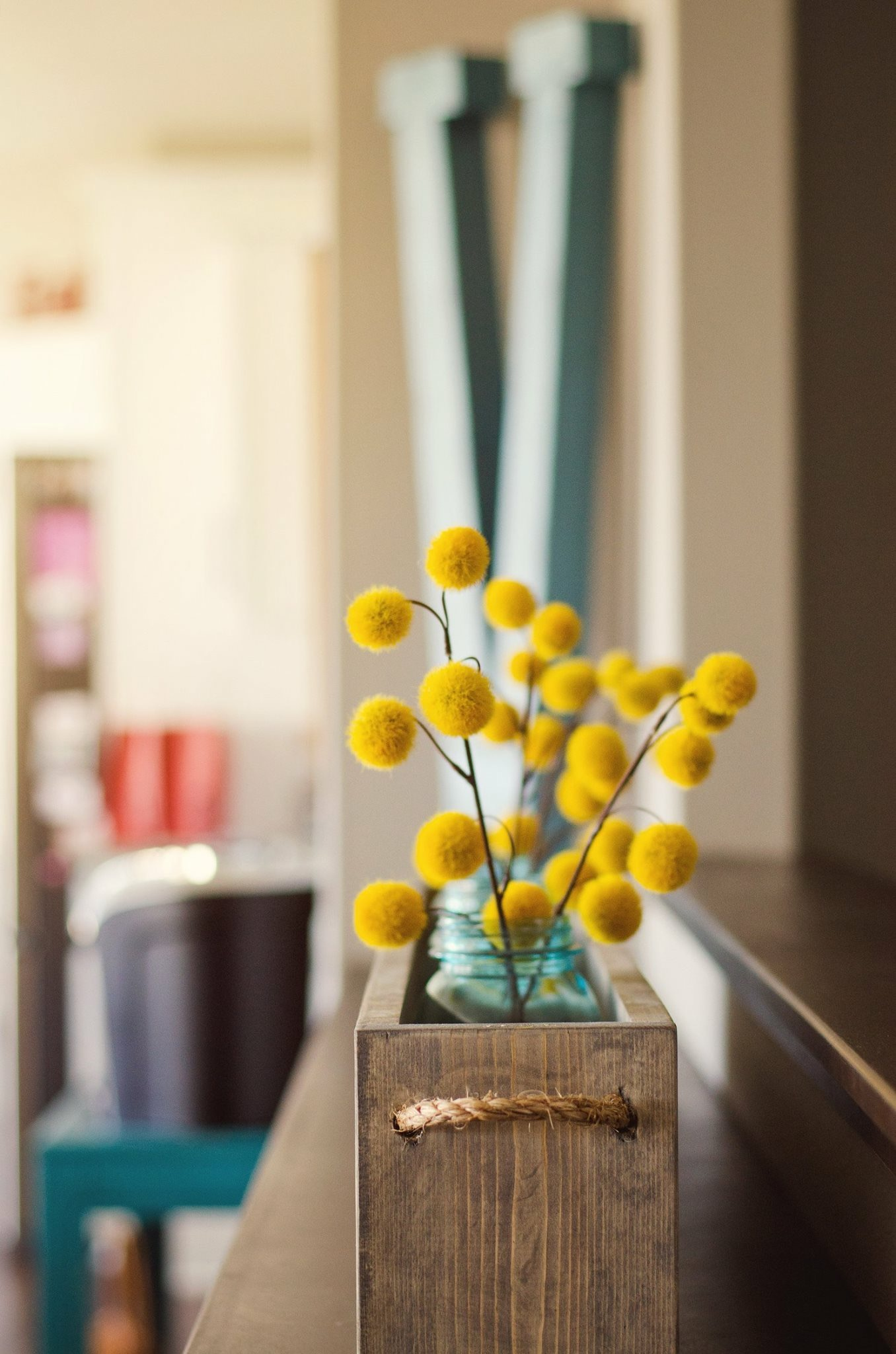 Yellow billy buttons in a wooden planter. RustopiaConsulting.com