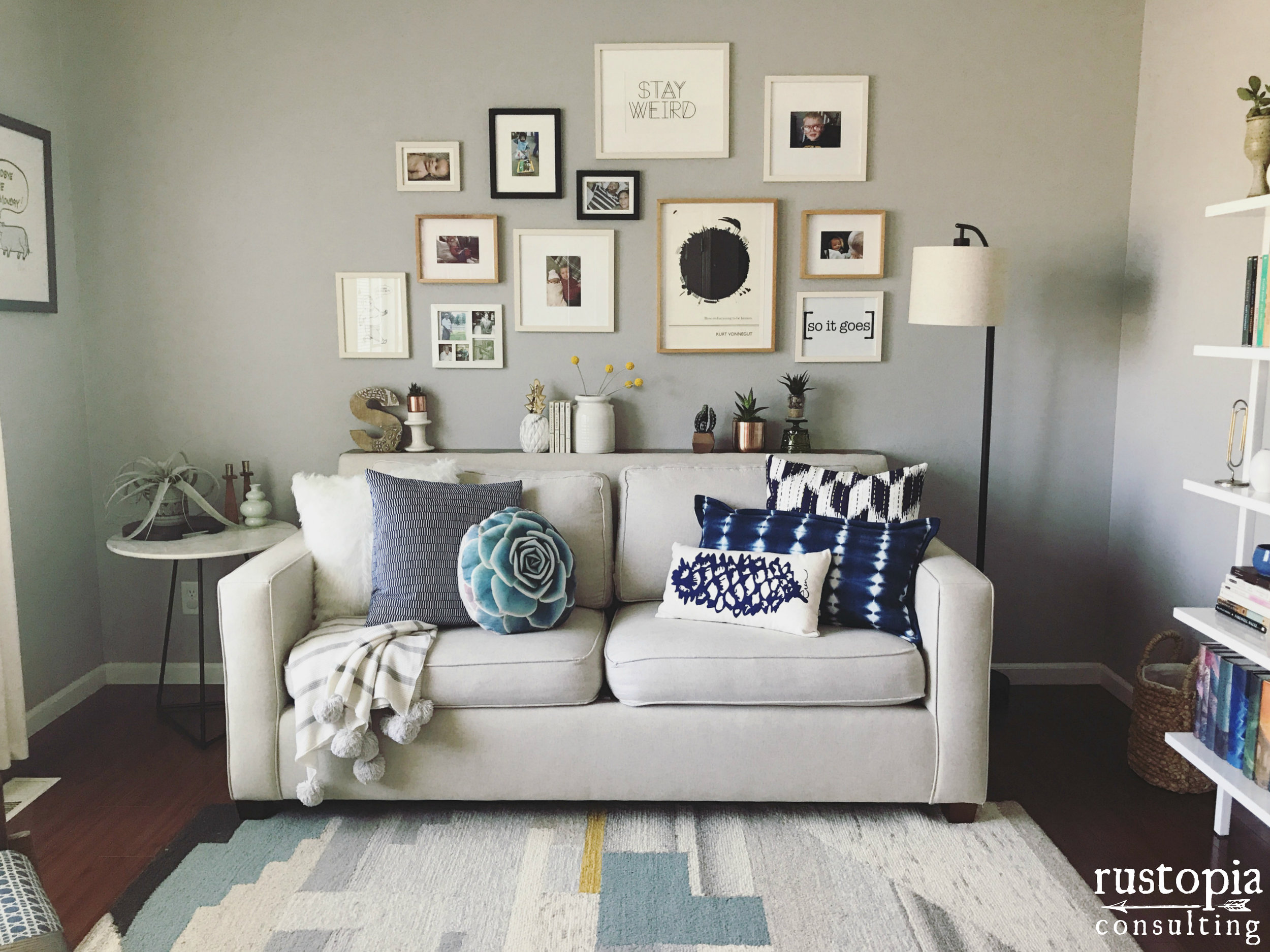 Living room design in neutral with pops of navy, black, and grey. | RustopiaConsulting.com