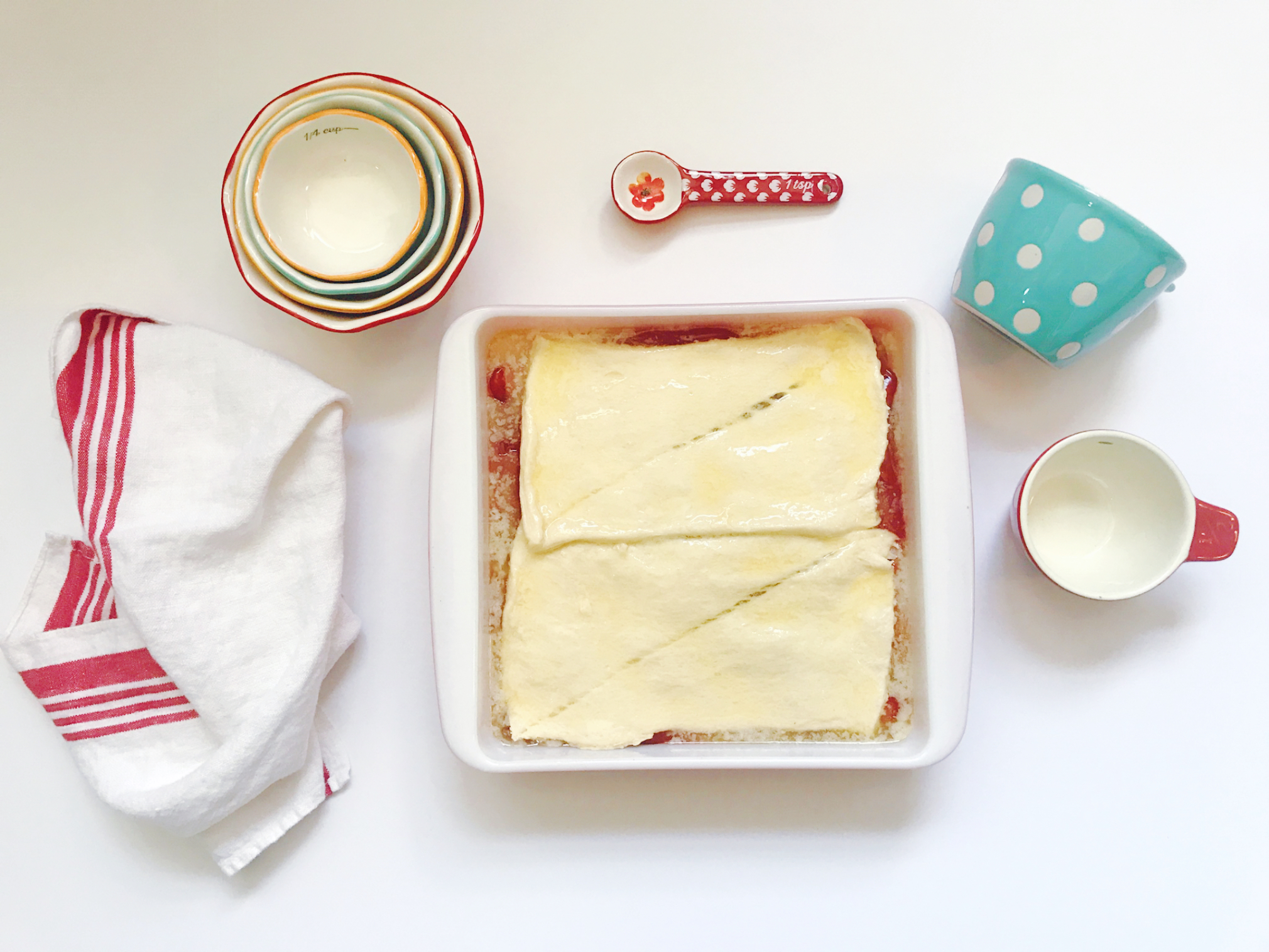 Cherry Cheesecake Bars in a baking dish | HPrallandCo.com