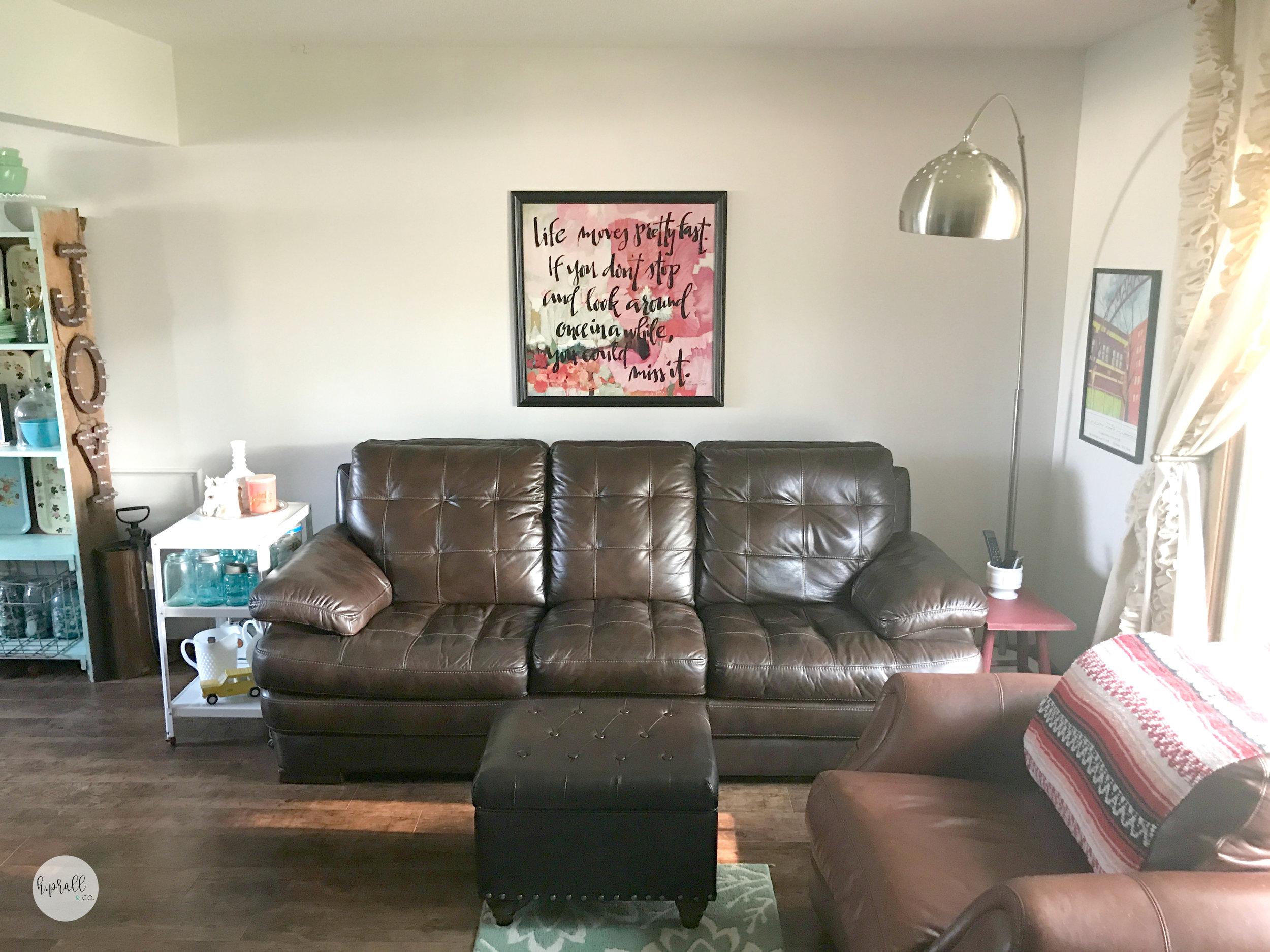 Living room with wall art via  H.Prall & Co.