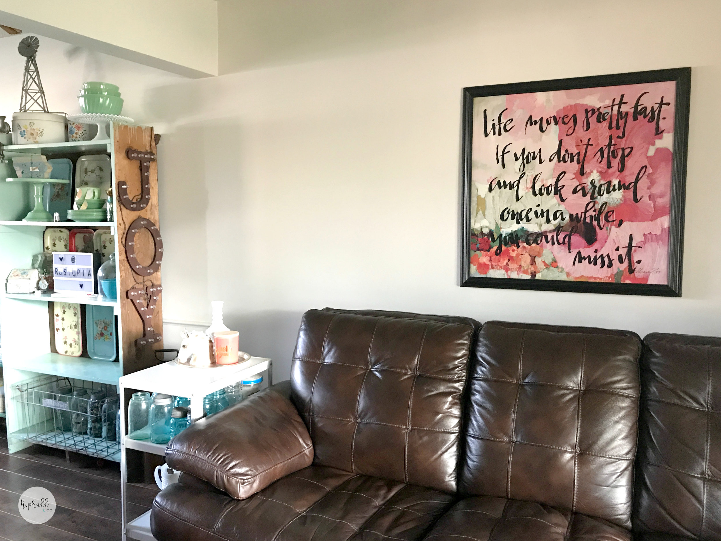 Living room with a hand lettered quote image wall decor via  H.Prall & Co.