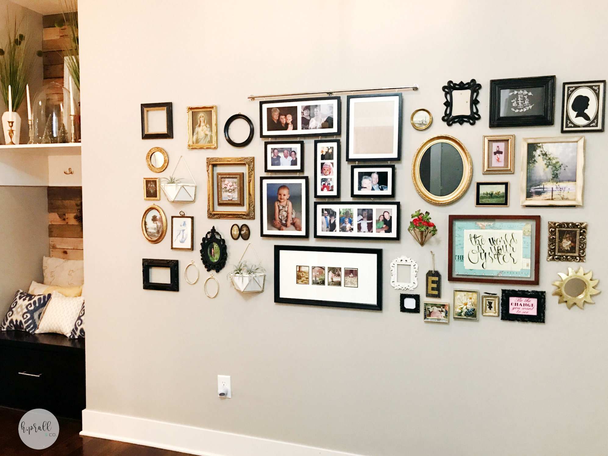 Large gallery wall design by H.Prall & Co. including dark and light frames, and all different shapes and textures.