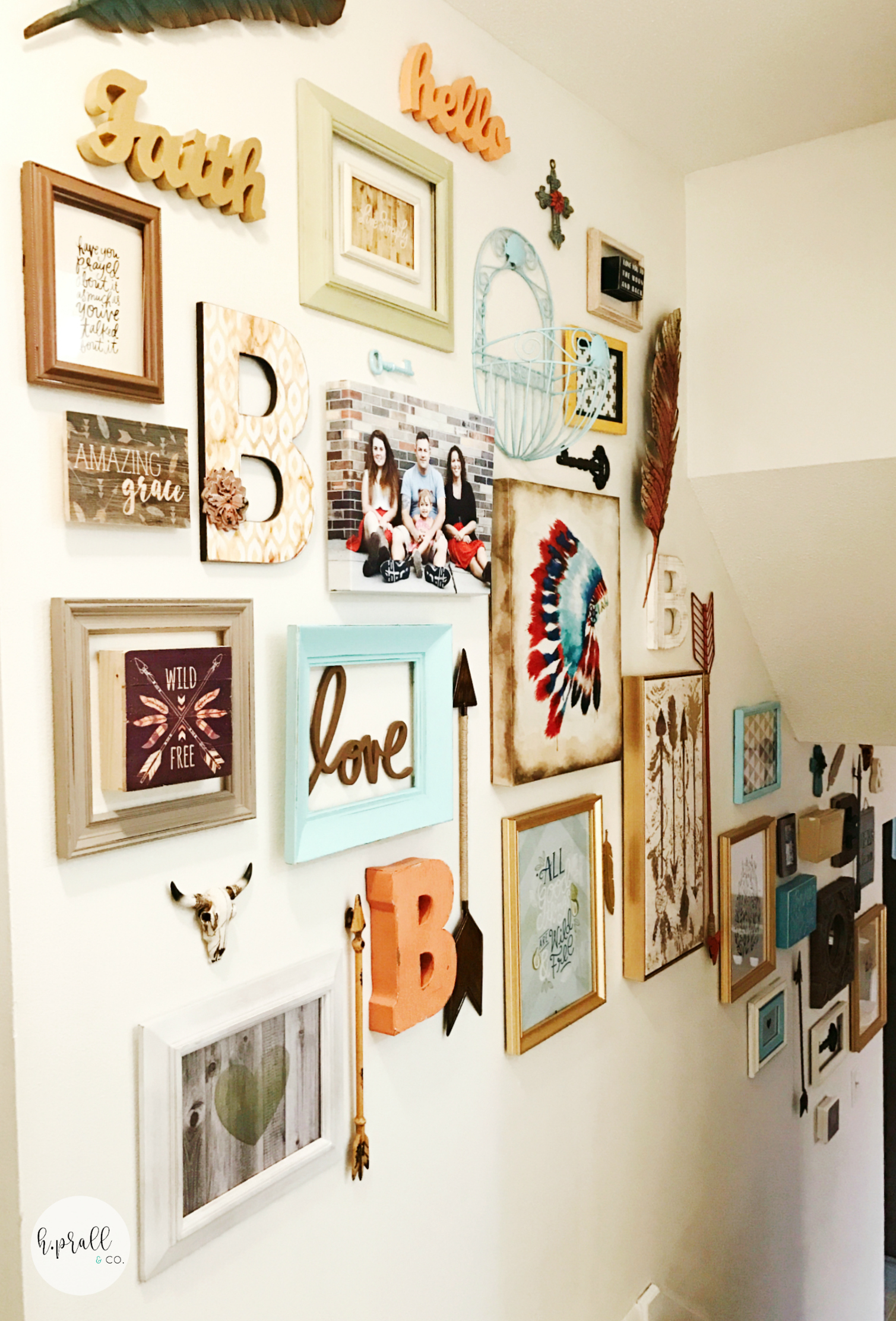 Gallery wall design over a staircase by H.Prall & Co.