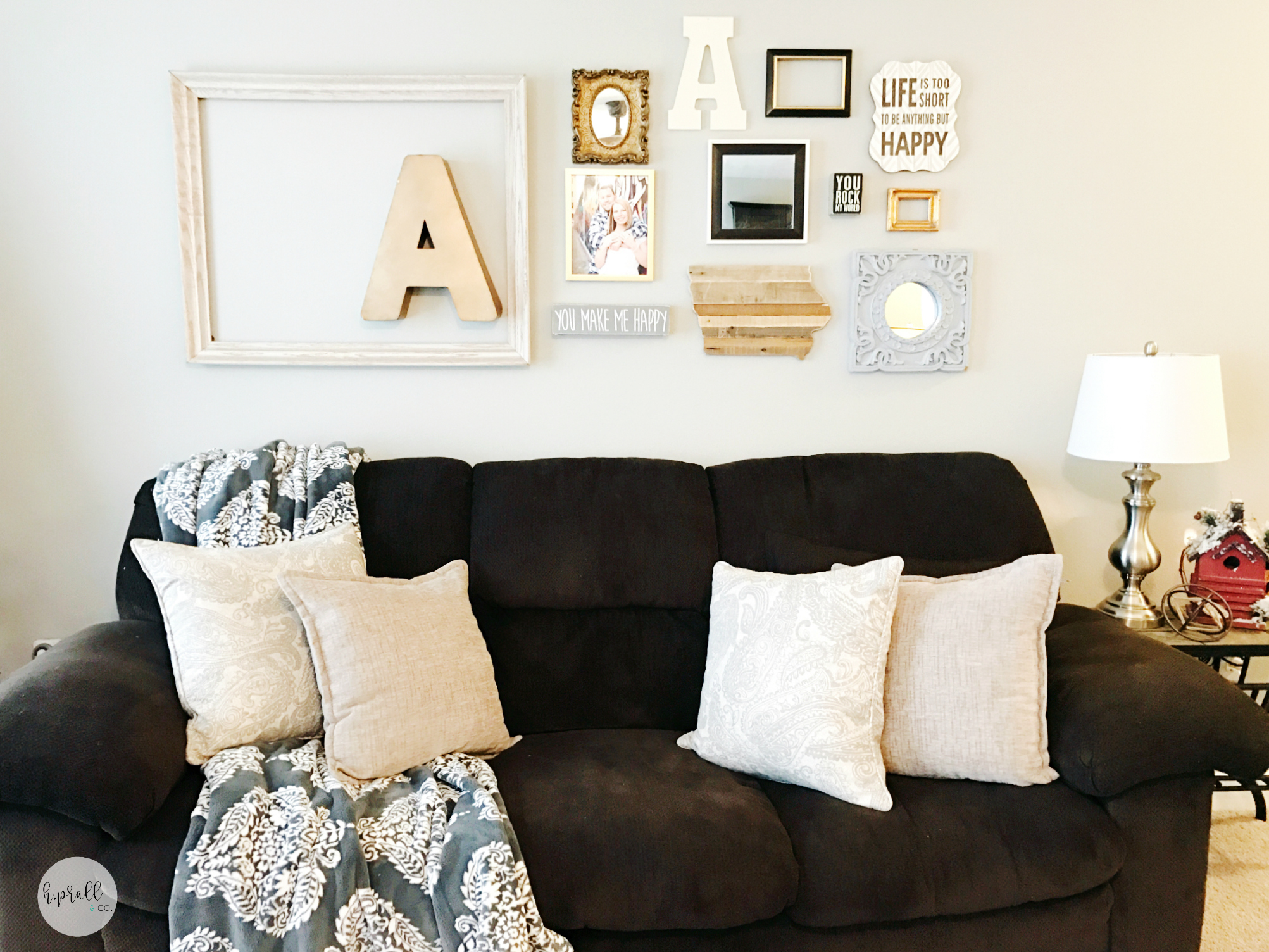 Simple gallery wall layout and design by H.Prall & Co. with a neutral color palette.
