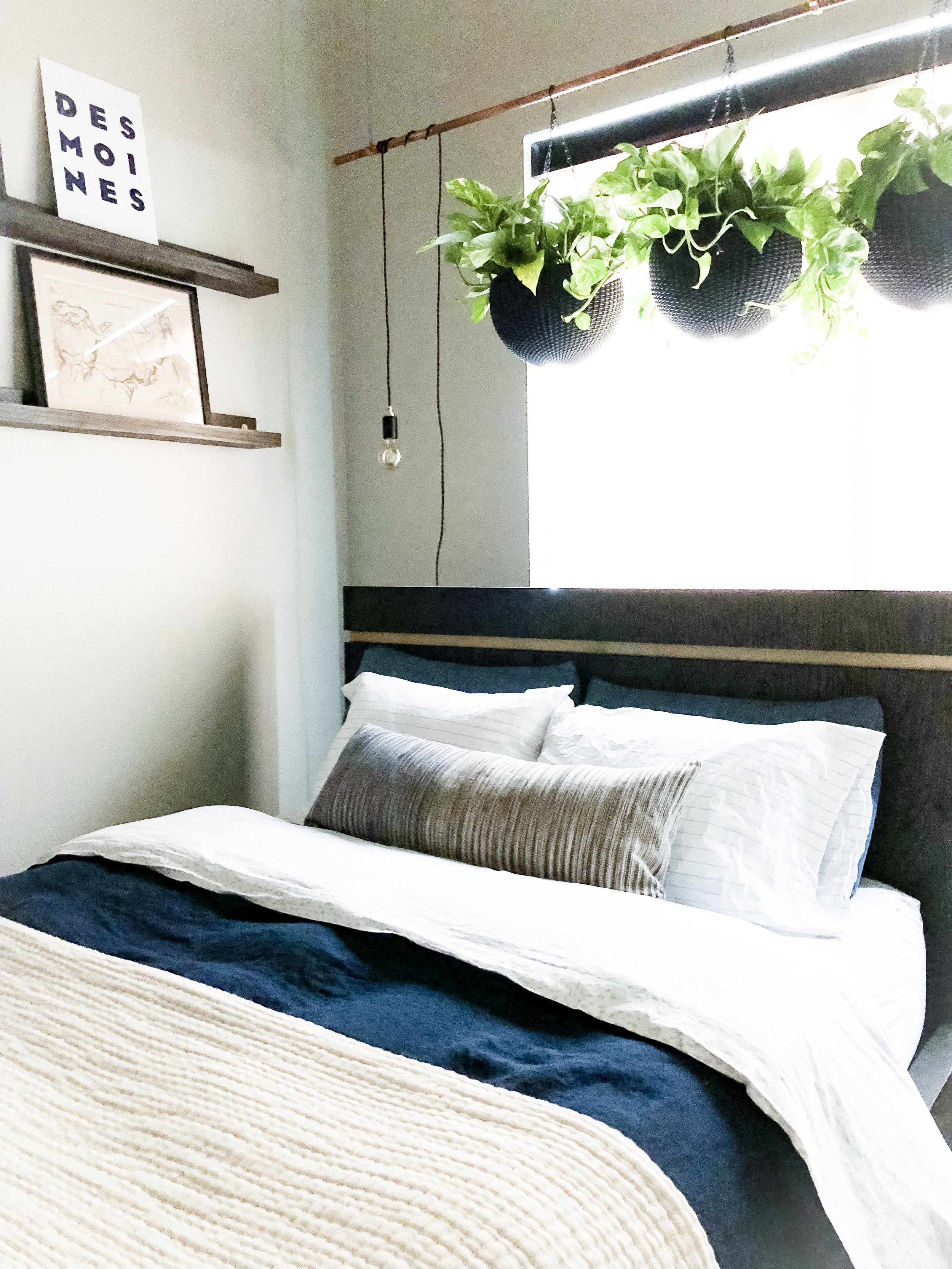 I can't get enough of this client bedroom I worked on in downtown Des Moines. It's a small space, but was seriously lacking in style. The West Elm bedding, floating shelves, and hanging plants breathed so much life into the room!