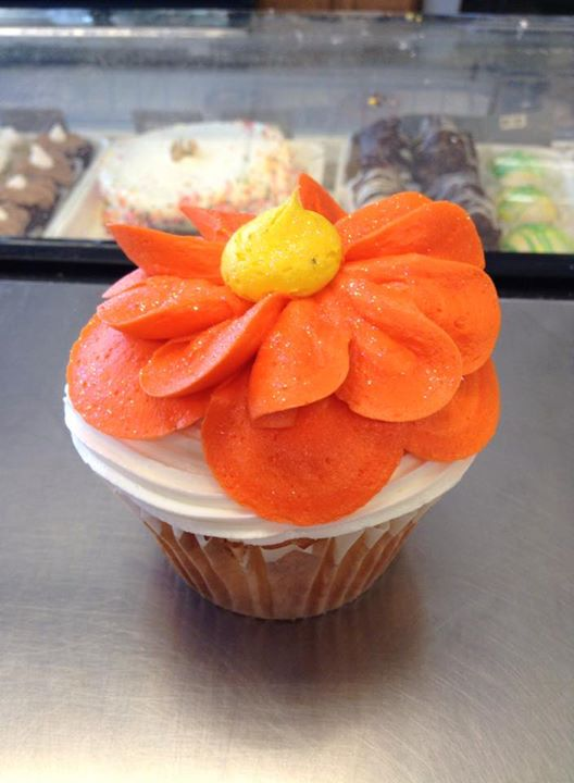 Giant flower cupcakes. Can be made with any flavor batter and a buttercream flower.