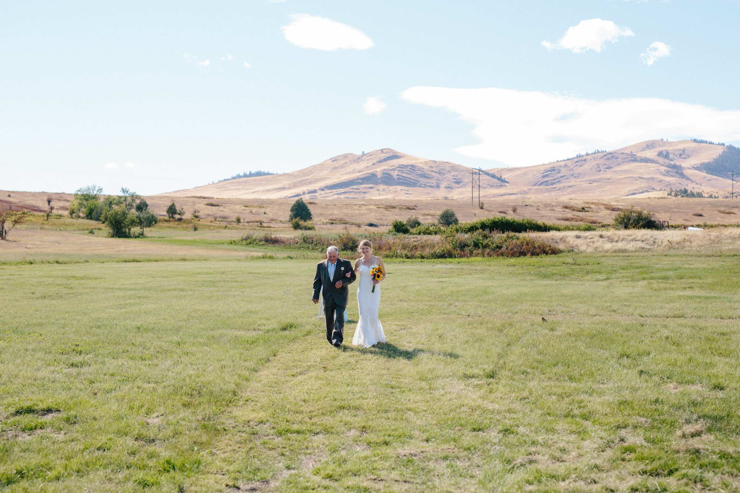 Take a walk down the aisle with the National Bison Range as your backdrop.  Photo by Dina Remi Studios.