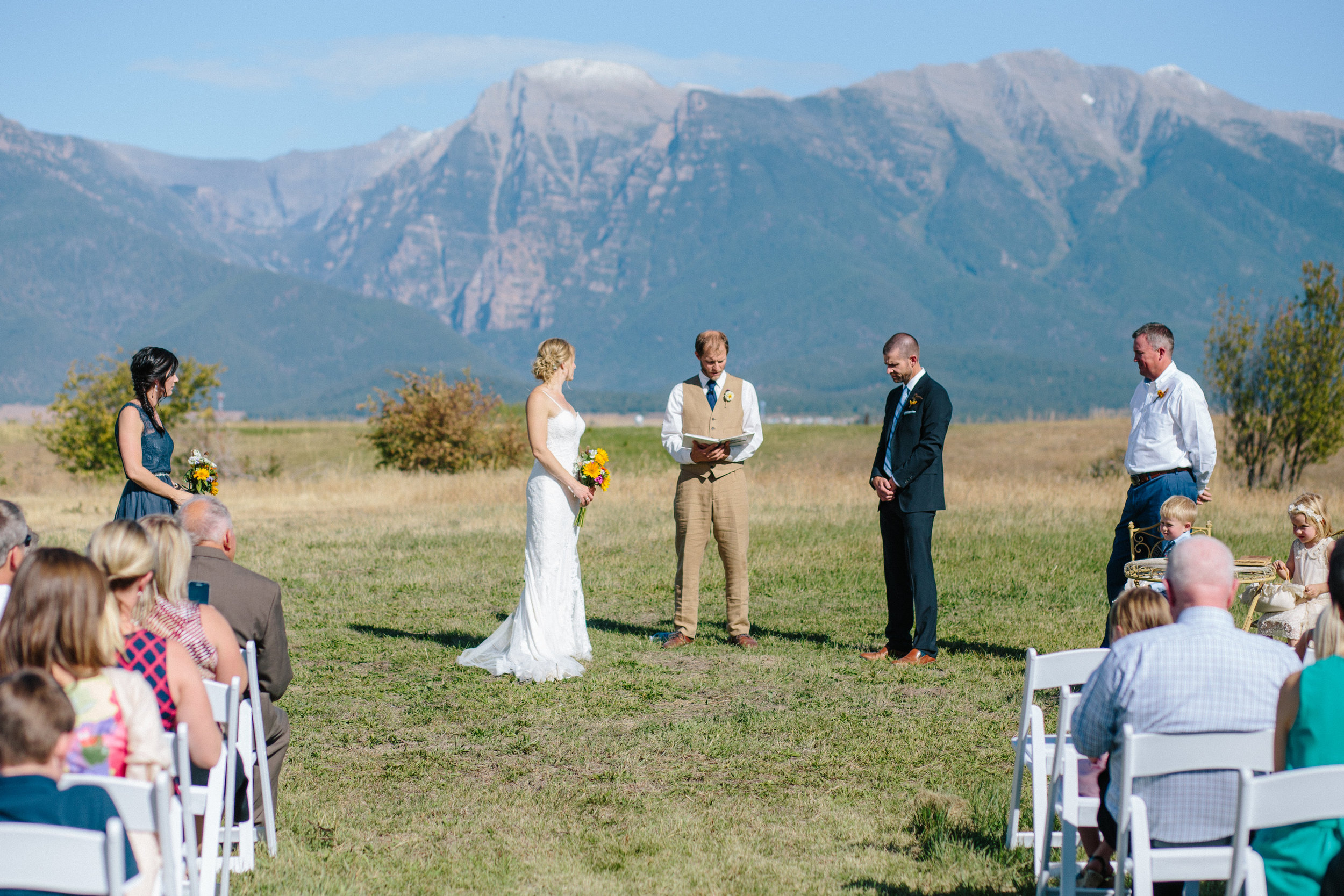 The lucky couple had snow-dusted peaks for their backdrop, even though it was 80 degrees during the ceremony. Photo by Dina Remi Studios.