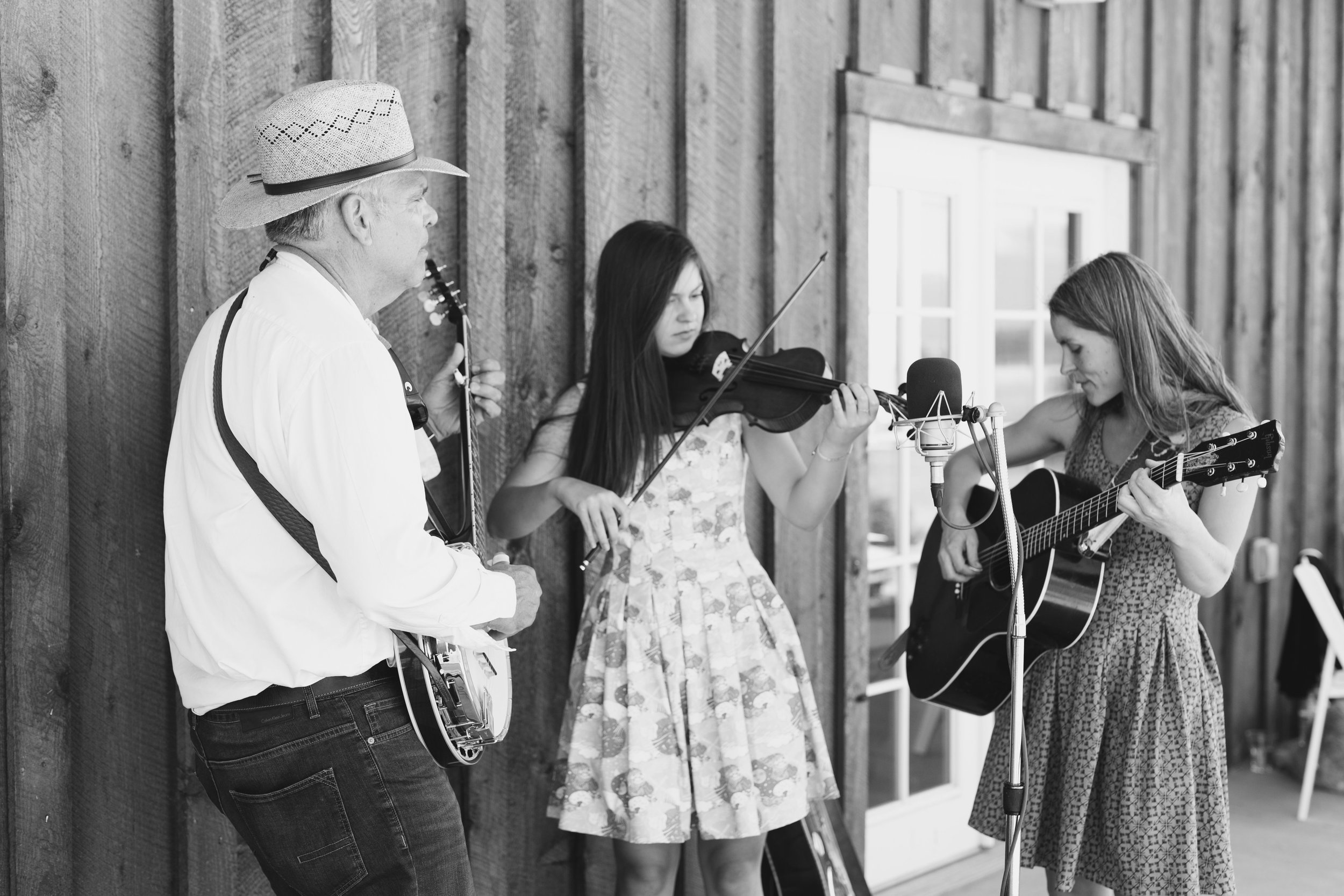 Clare Menehan and her band kept guests entertained with live music on the barn's patios. Photo By Dina Remi Studios.