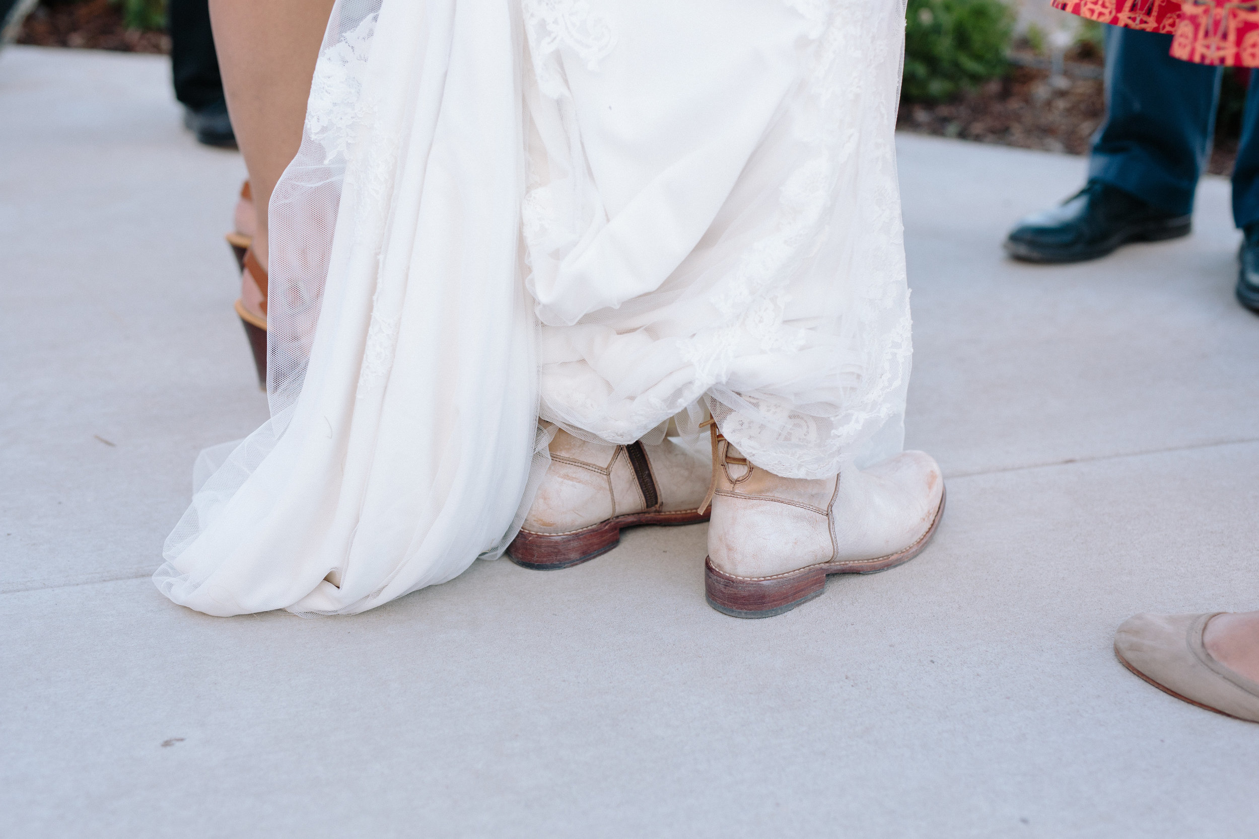We think boots are the best wedding accessory. Photo by Dina Remi Studios.
