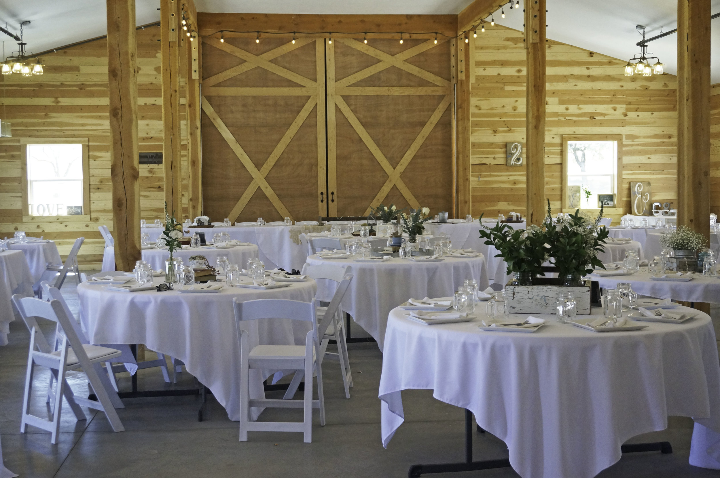 The barn looked elegant with all the handmade signs and beautiful greenery.