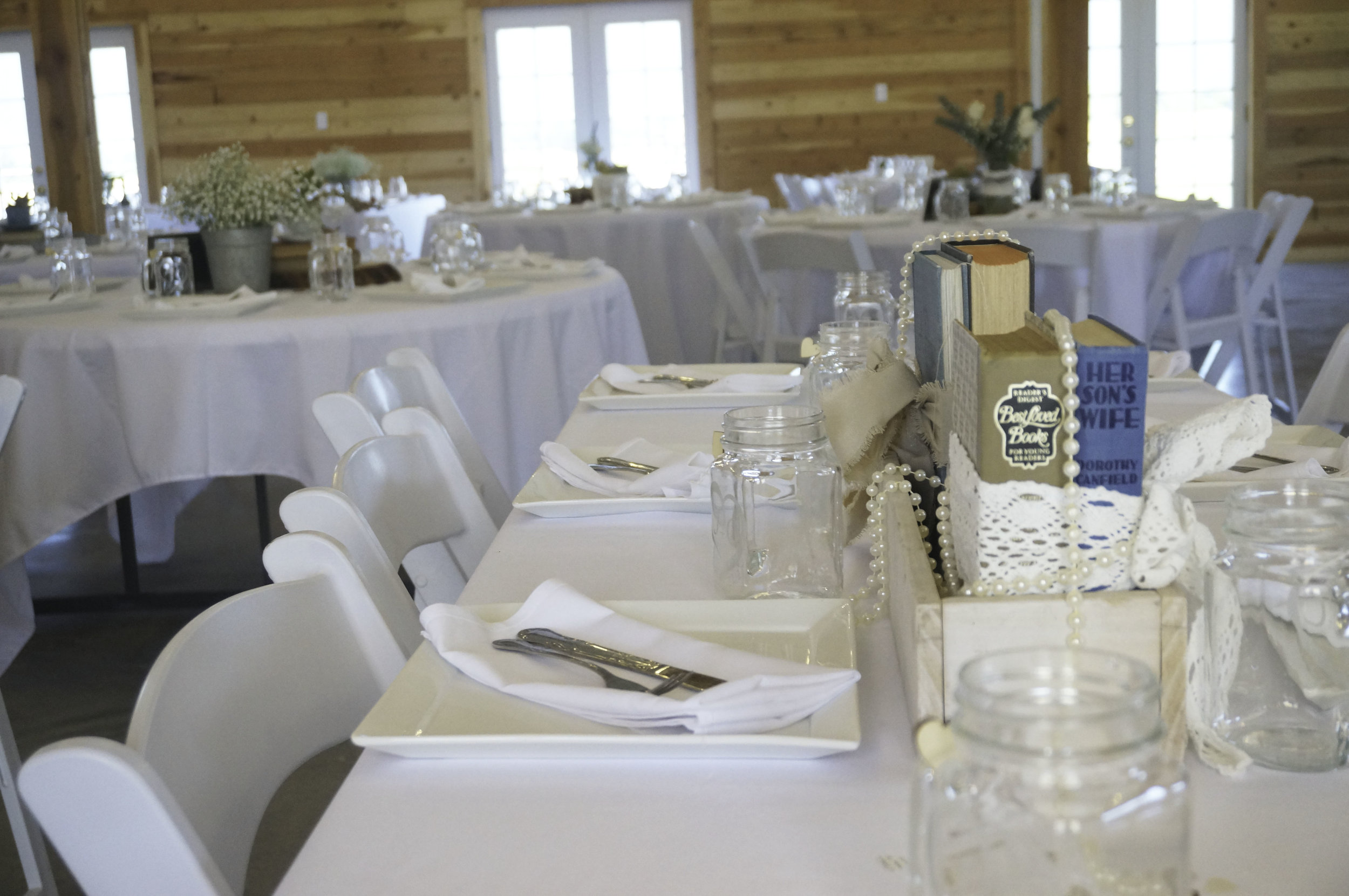 The bride collected vintage items, including old books, to decorate the tables.