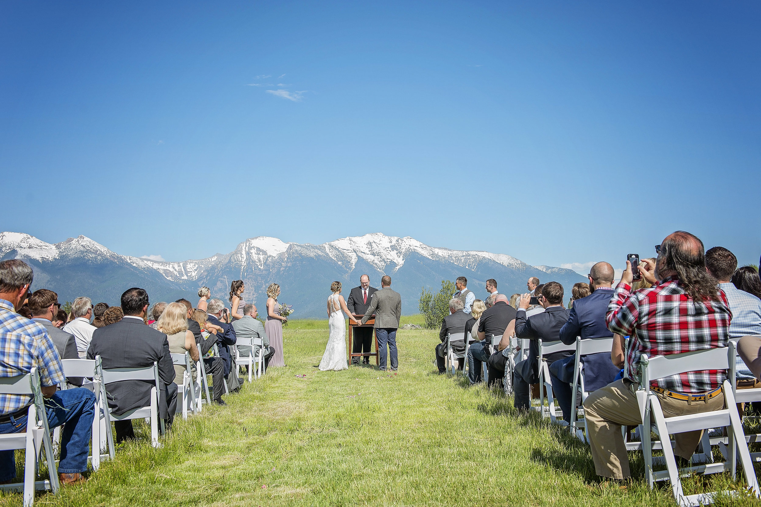 Exchanging vows in the Meadow at Rugged Horizon. Photo Credit:  Eden Bryant Photography