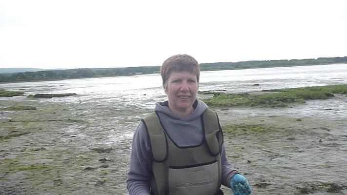 Ann's idea of fun? Conducting research in the mudflats of Southern England.