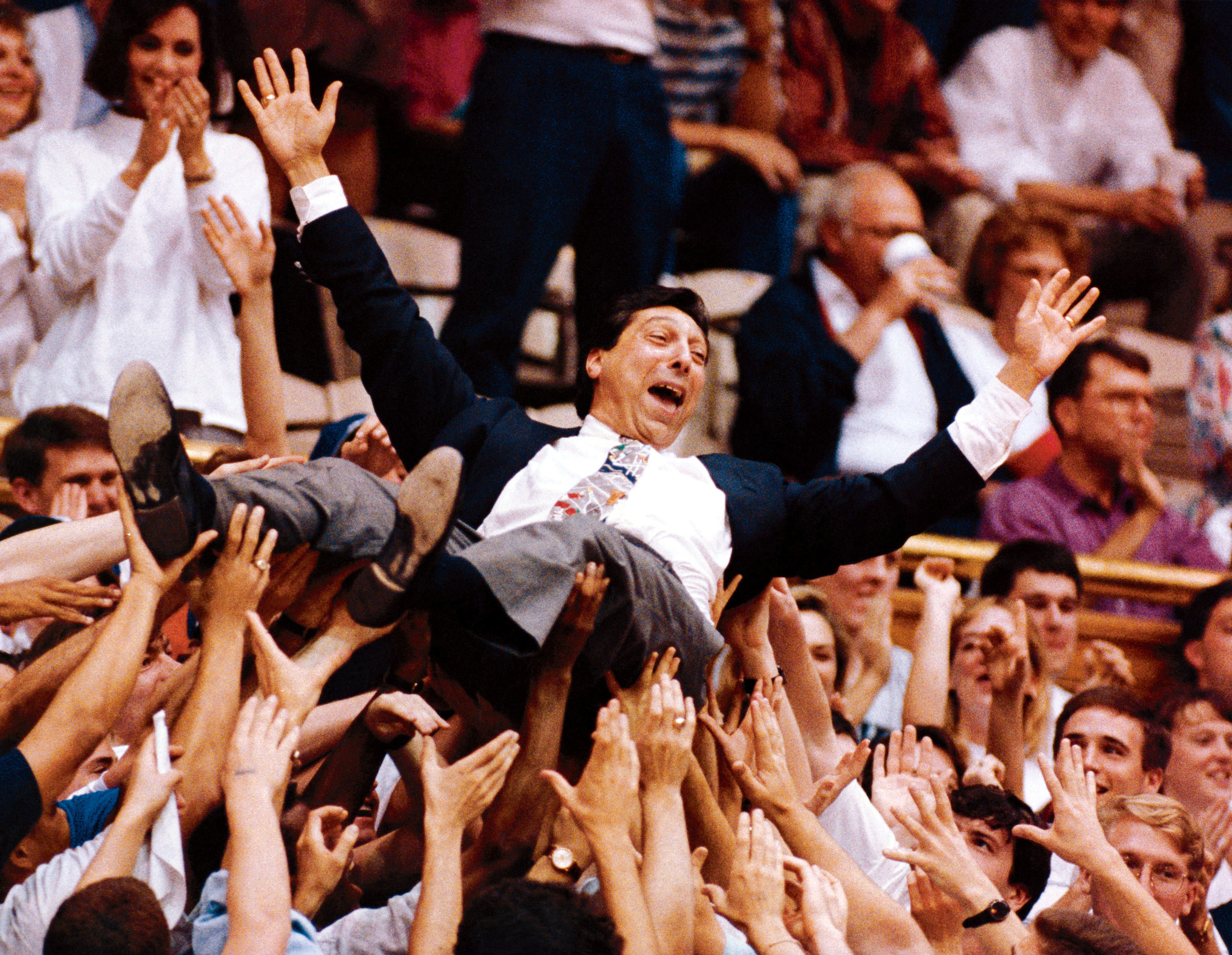 Valvano crowdsurfs while announcing a game in the early 1990s.