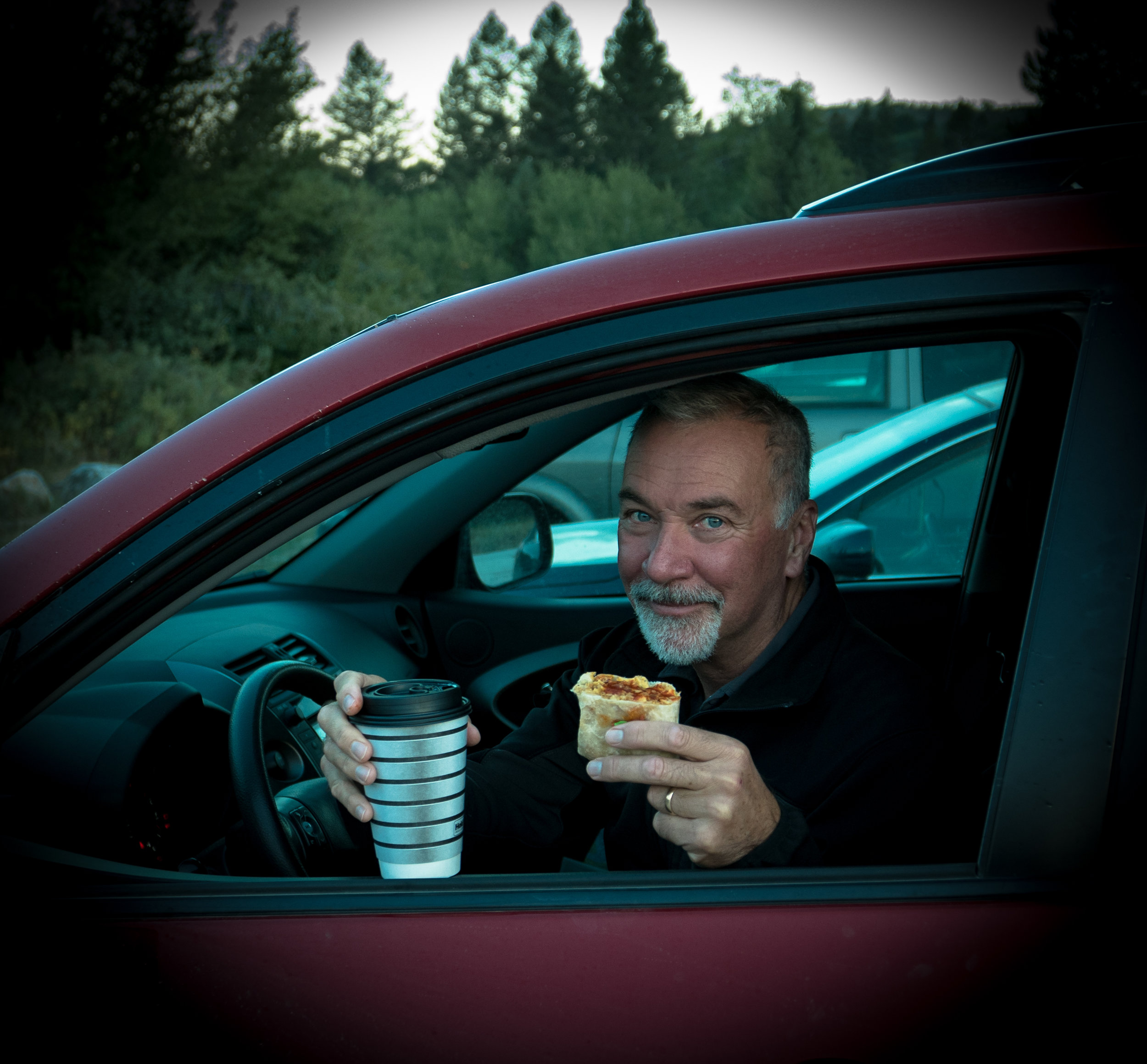Keith is a Happy Camper with his morning coffee and breakfast burrito.