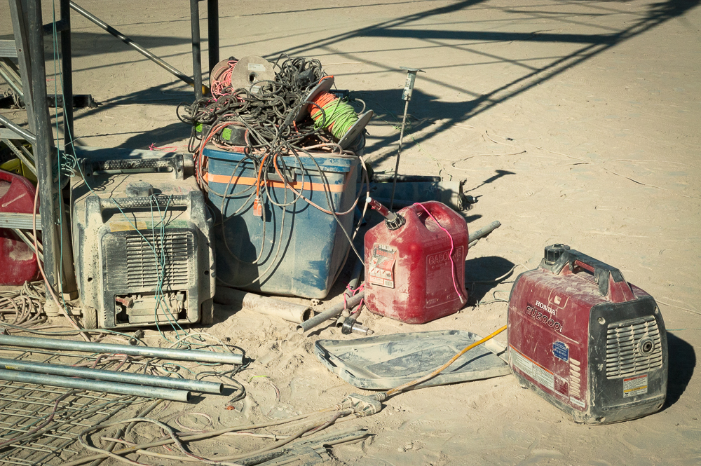 Gasoline on the playa is programatic. When spilled it makes one heck of a mess. Earth Guardians remind people to keep their gas cans safely contained and away from the generator.