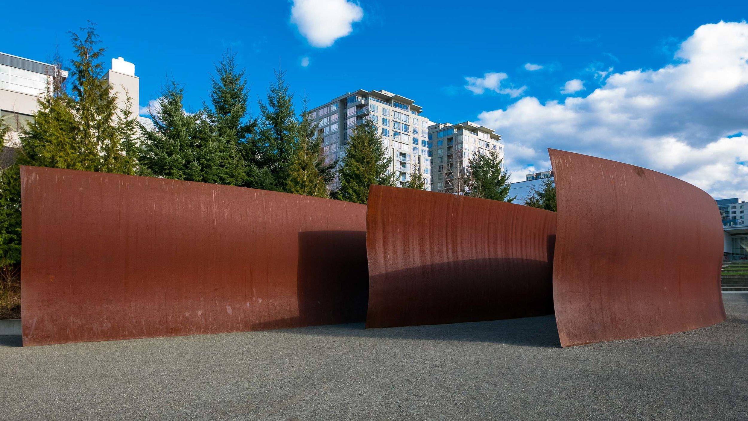 "Day 3. Shadows on Richard Serra's five-part steel sculpture ""Wake"" on the waterfront walkaway."