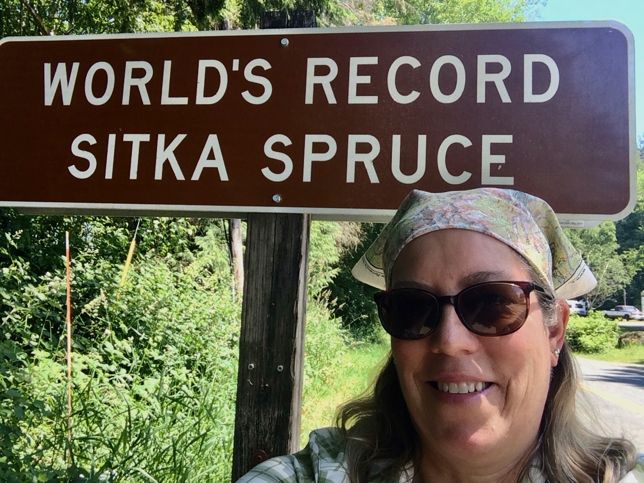 Selfie by the sign, not on the roots of the World's Largest Sitka Spruce.