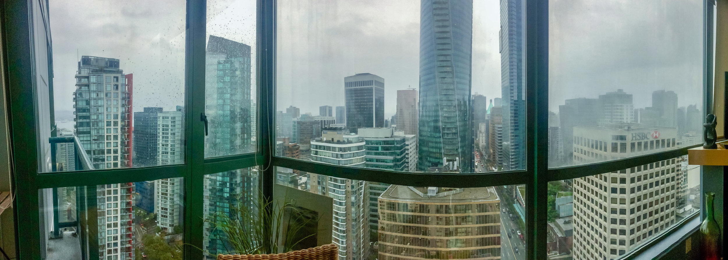 A room with a high rise urban view. Vancouver, B.C.