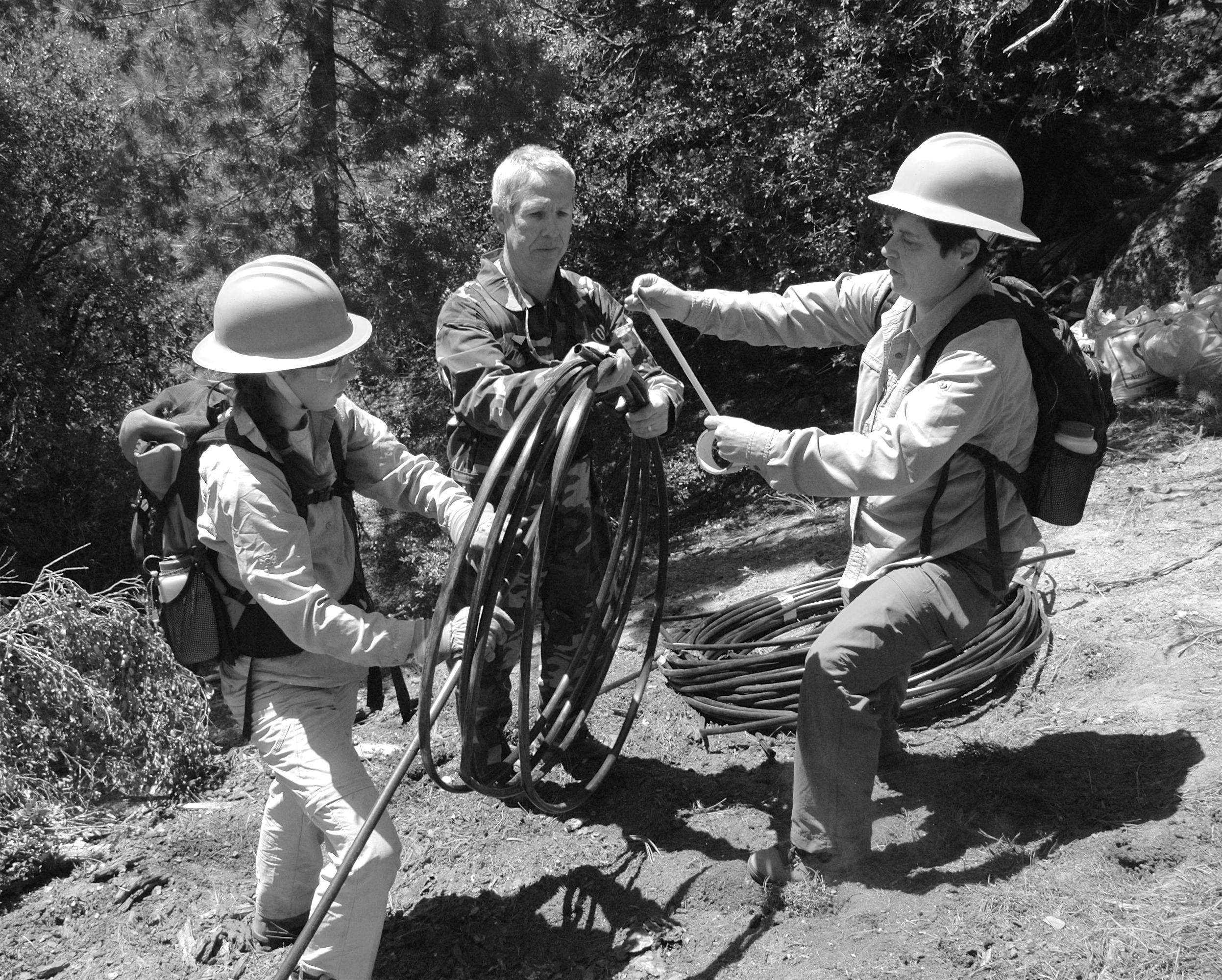 """""""We crawled on our hands and knees, following the black pipe from one abandoned campsite to another. Volunteers gingerly picked up rotting trash, rolled up irrigation pipe and gathered bags for California Highway Helicopter H-40 to haul away."""""""
