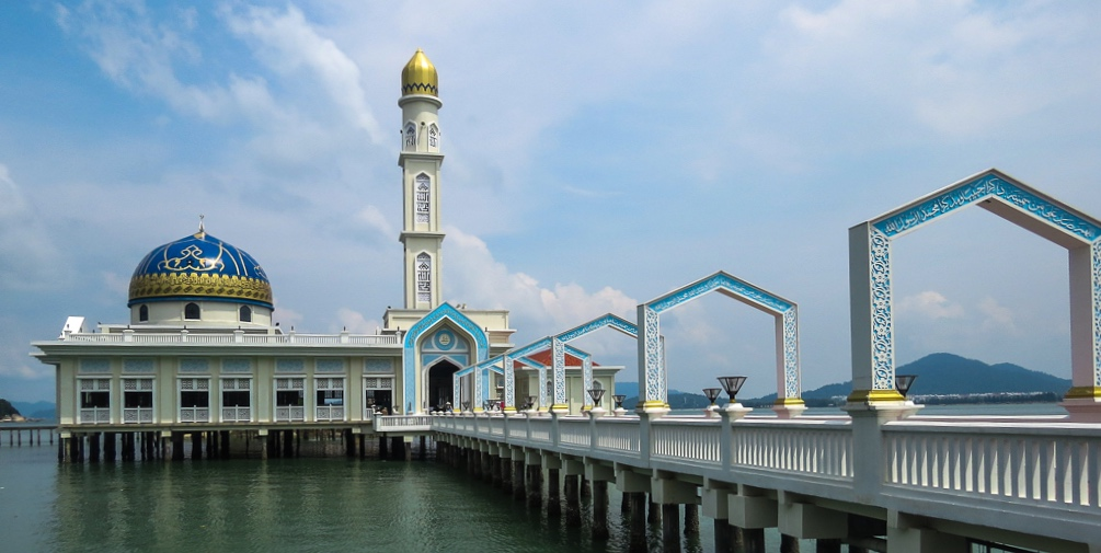 On our scooter ride around the island we stopped at a beautiful new mosque over the water.