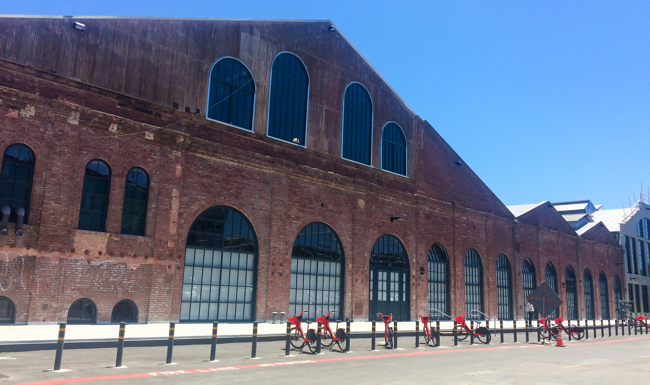 A historic building with new bikes for rent.