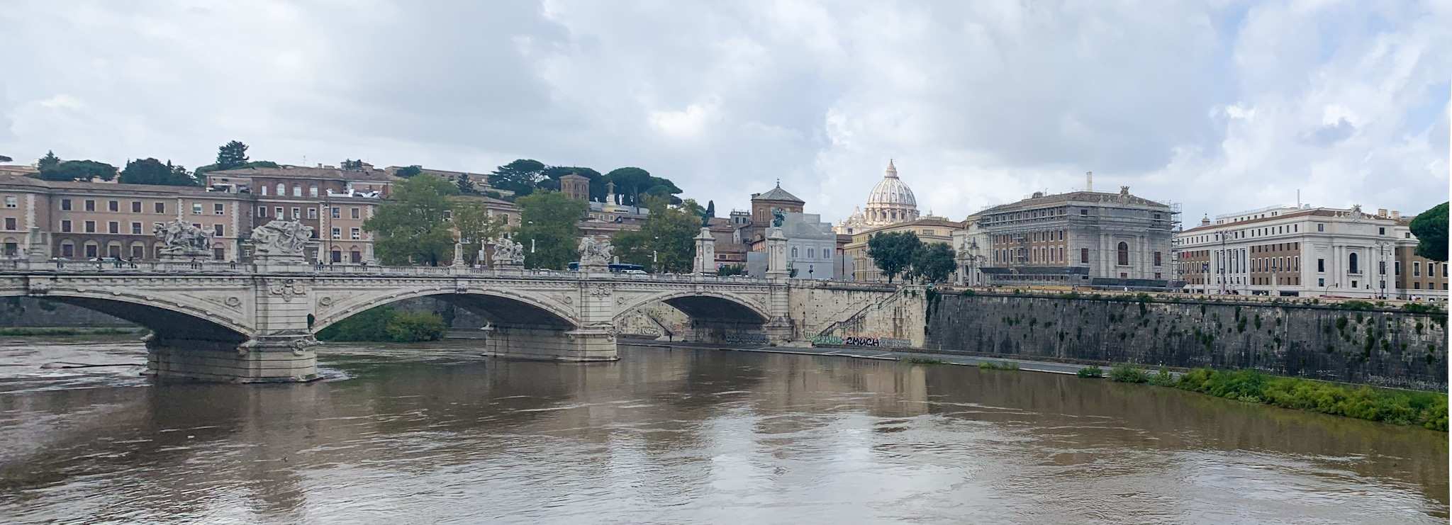 Rome, and a distant view of the dome of St. Peter's Basilica.