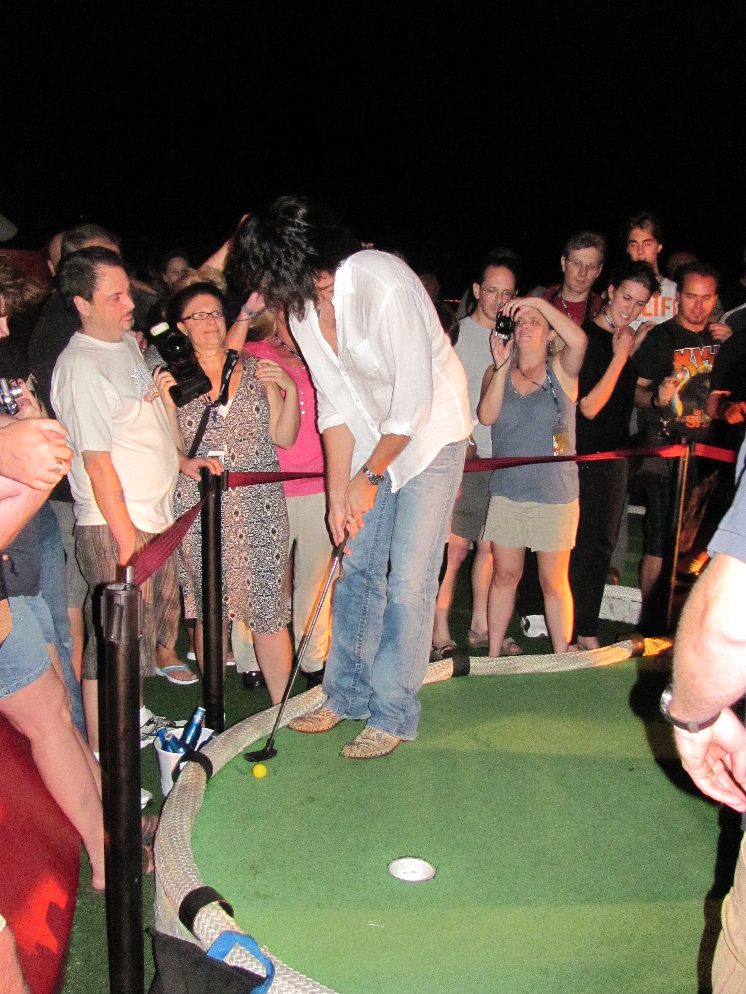 Kiss guitarist Tommy Thayer participated in a min-golf tourney on the Kiss Kruise in 2011.