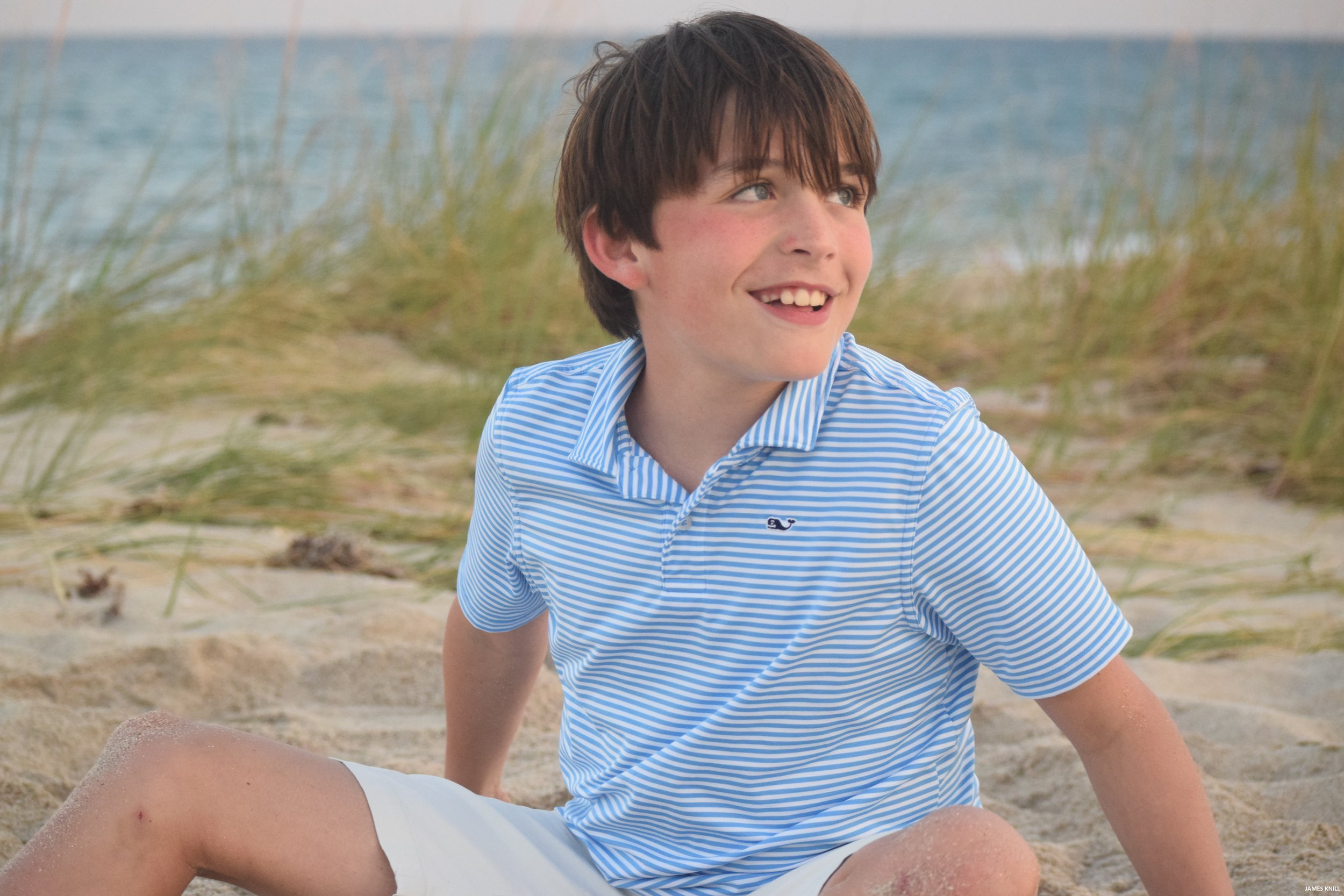 Portrait Of A Boy On The Beach. Photography By James Knill